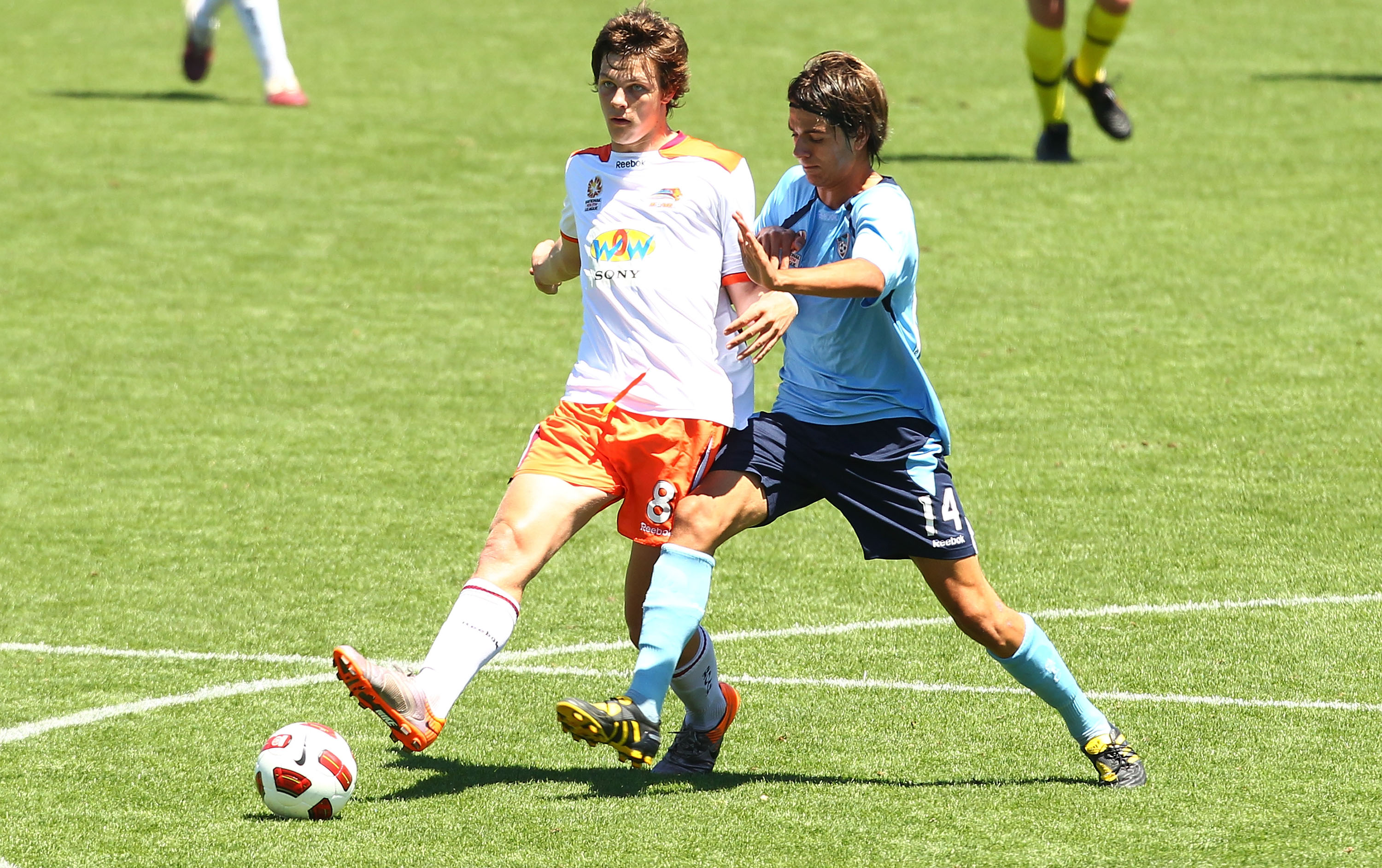 WOLLONGONG, AUSTRALIA - DECEMBER 11: James Donachie of the Roar and Peter Simonski of Sydney contest possession during the round 13 Youth League match between Sydney FC and the Brisbane Roar at WIN Stadium on December 11, 2010 in Wollongong, Australia.  (