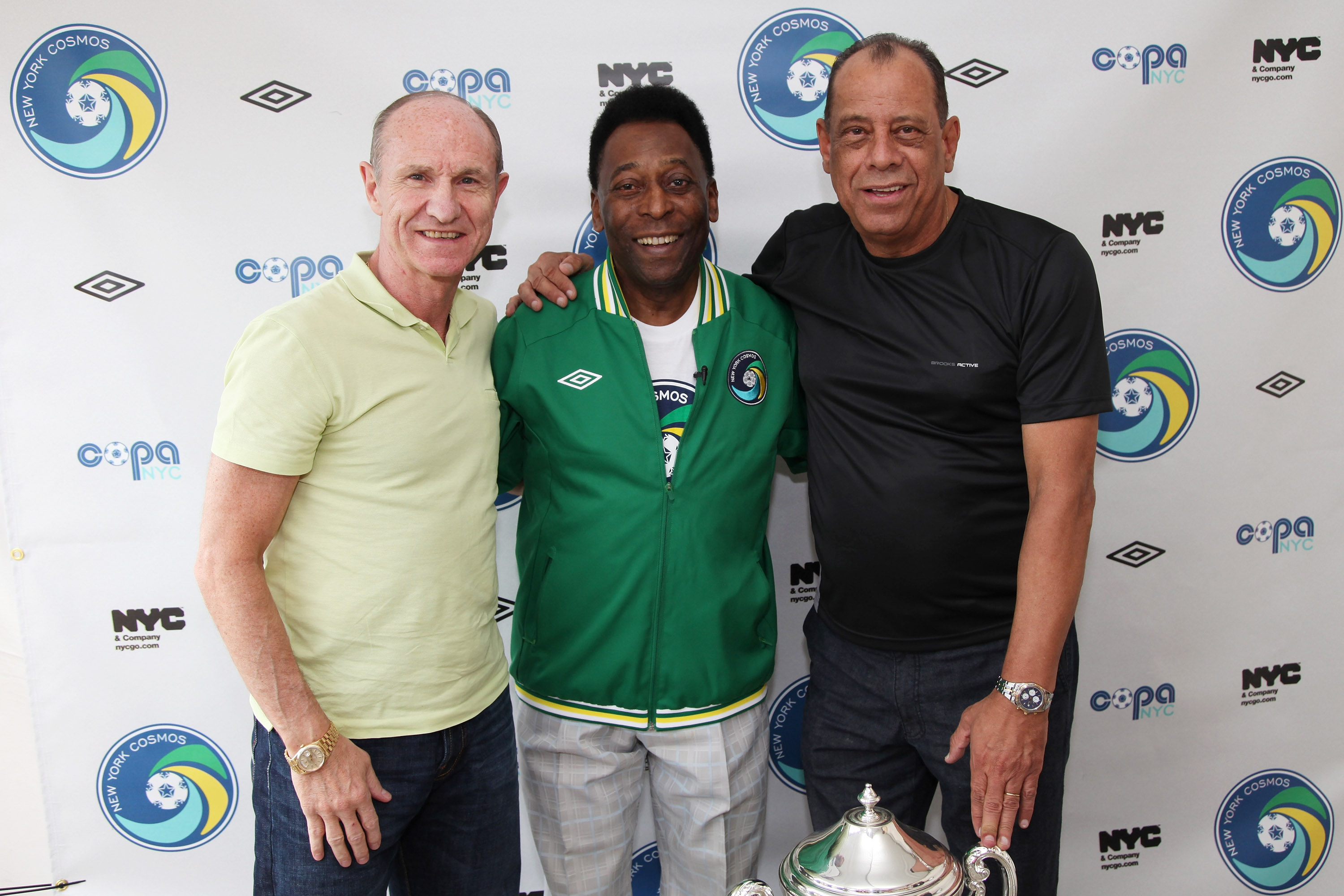 NEW YORK - AUGUST 01:  Soccer Legend Pele (C) and former team mates Dennis Tueart (L) and Carlos Alberto Torres (R)  pose for a photograph before the announcement of the return of the World Renowned New York Cosmos at Flushing Meadows Corona Park on Augus