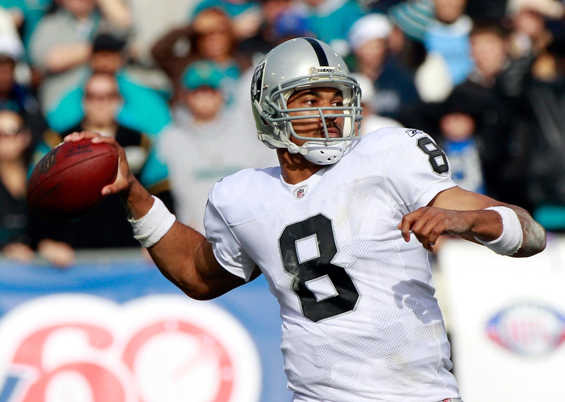 JACKSONVILLE, FL - DECEMBER 12:  Jason Campbell #8 of the Oakland Raiders attempts a pass during the game against the Jacksonville Jaguars at EverBank Field on December 12, 2010 in Jacksonville, Florida.  (Photo by Sam Greenwood/Getty Images)