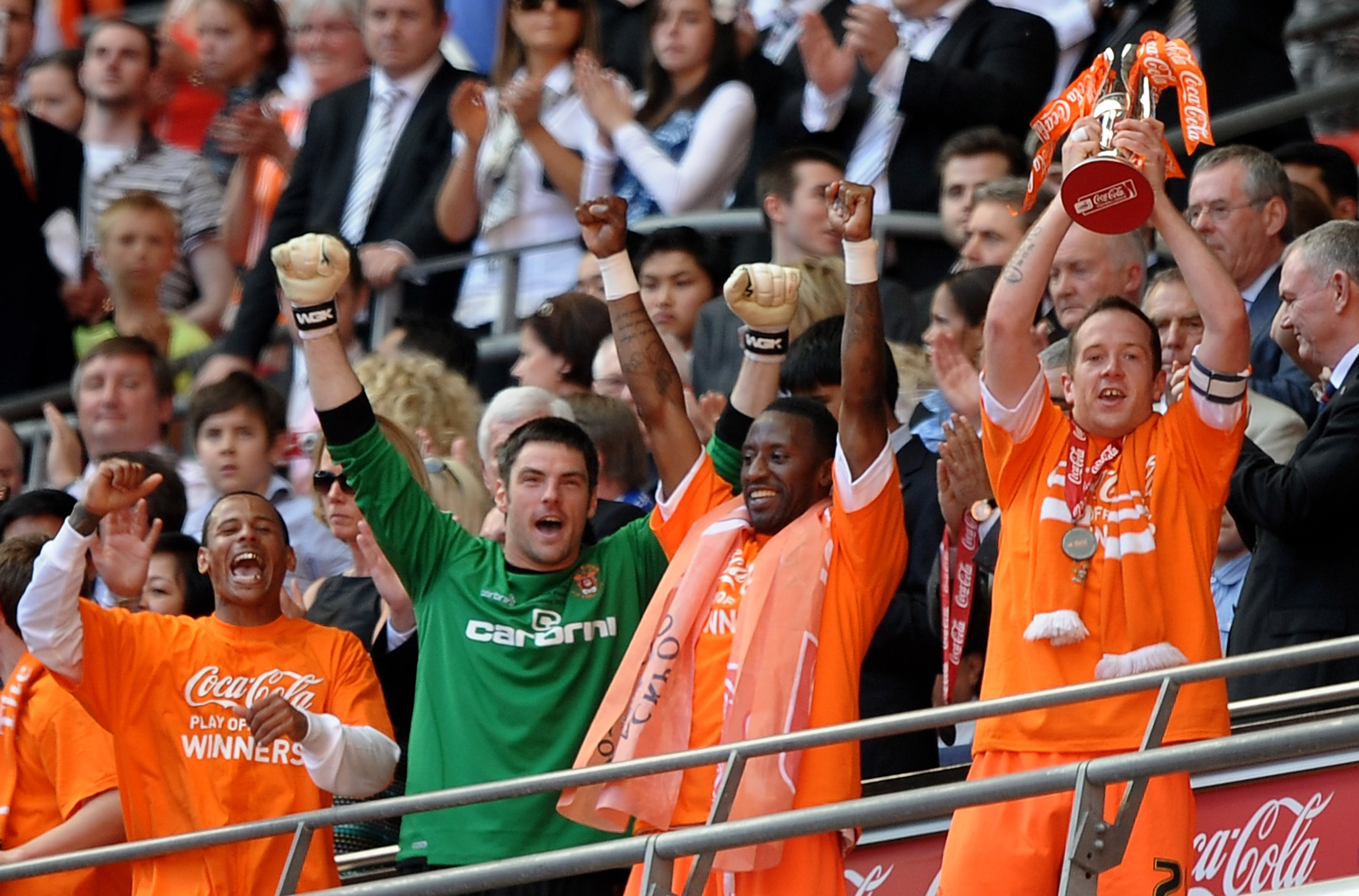 LONDON, ENGLAND - MAY 22:  Charlie Adam and the Blackpool team celebrate promotion during the Coca-Cola Championship Playoff Final between Blackpool and Cardiff City at Wembley Stadium on May 22, 2010 in London, England.  (Photo by Laurence Griffiths/Gett