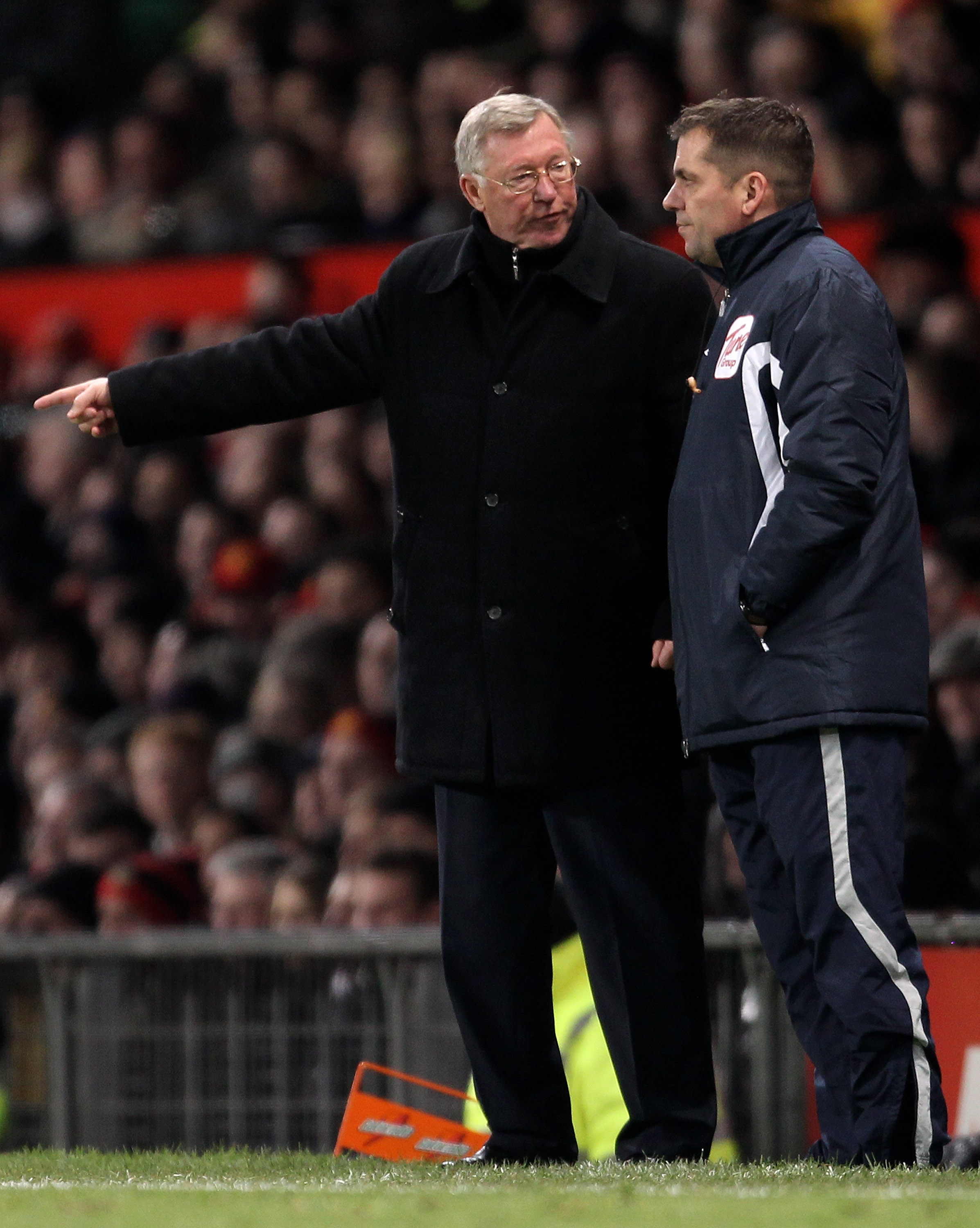MANCHESTER, ENGLAND - DECEMBER 13:  Manchester United Manager Sir Alex Ferguson protests to Fourth Official Phil Dowd during the Barclays Premier League match between Manchester United and Arsenal at Old Trafford on December 13, 2010 in Manchester, Englan
