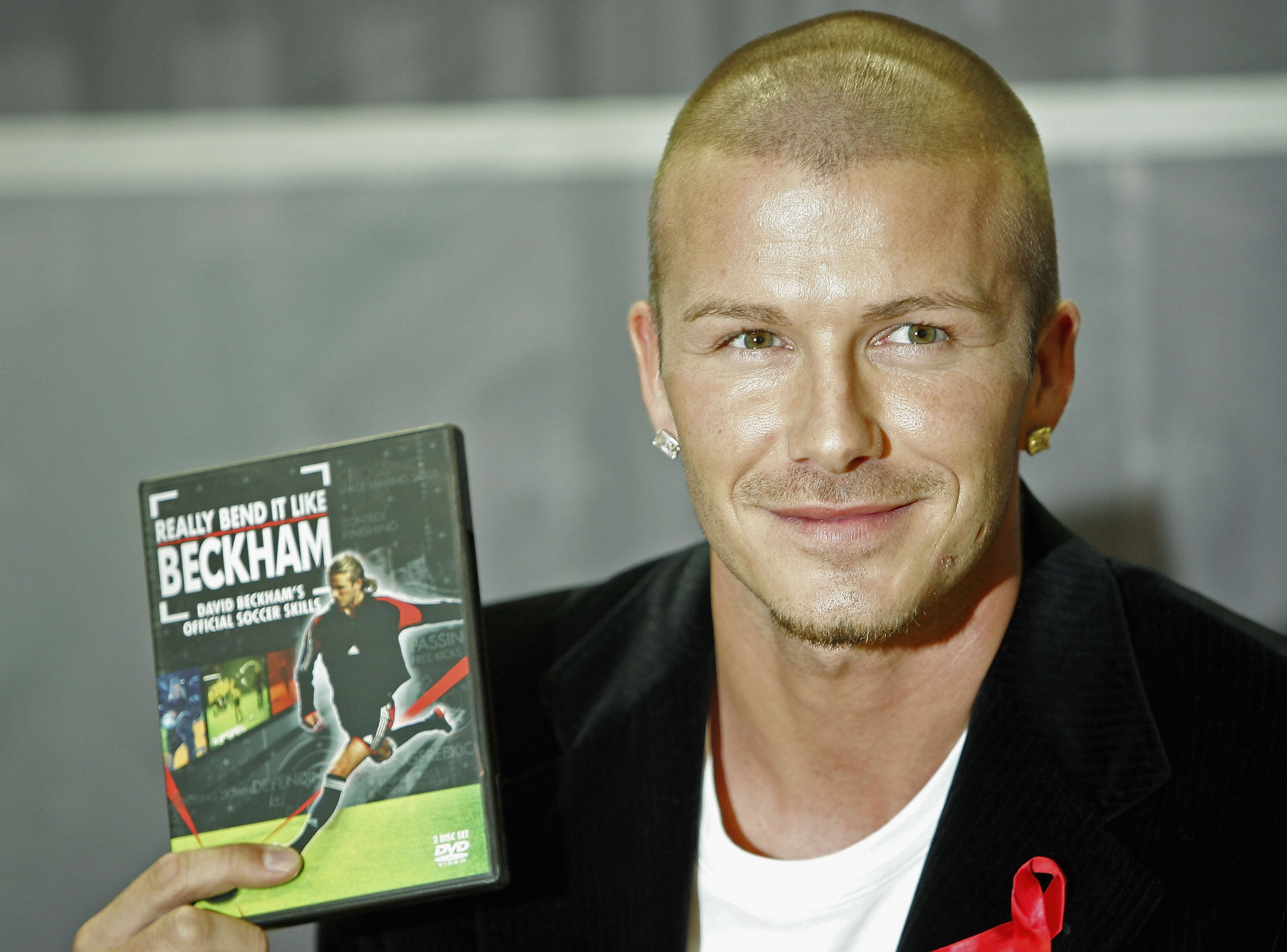 LONDON - DECEMBER 1:  Real Madrid and England footballer David Beckham promotes 'Really Bend It Like Beckham', his first official training skills DVD, at the Virgin Megastore, Oxford Street on December 1, 2004 in London. (Photo by MJ Kim/Getty Images)