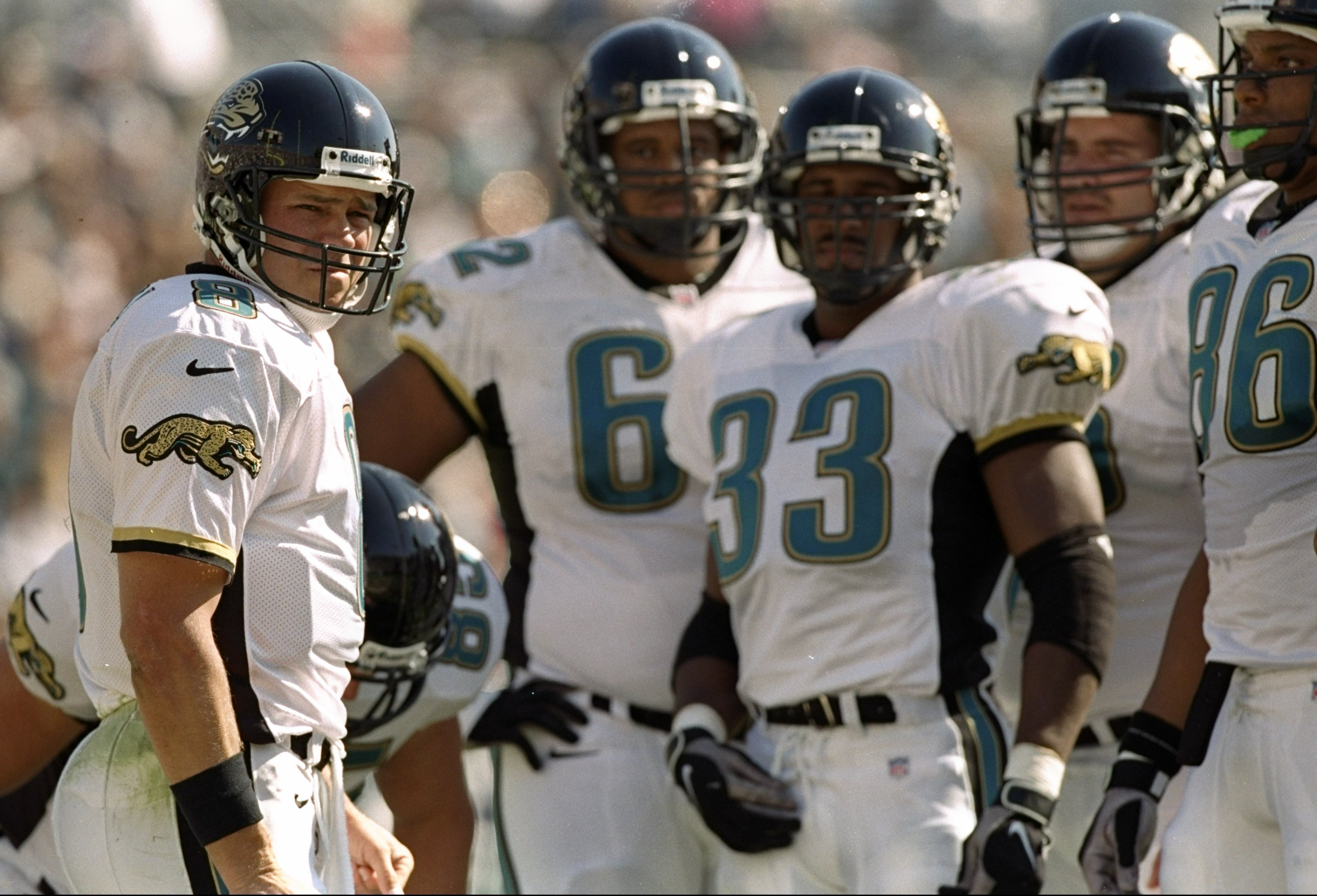 9 Nov 1997:  Quarterback Mark Brunell of the Jacksonville Jaguars (left) looks on with some of his teammates during a game against the Kansas City Chiefs at Alltell Stadium in Jacksonville, Florida.  The Jaguars won the game 24-10. Mandatory Credit: Andy
