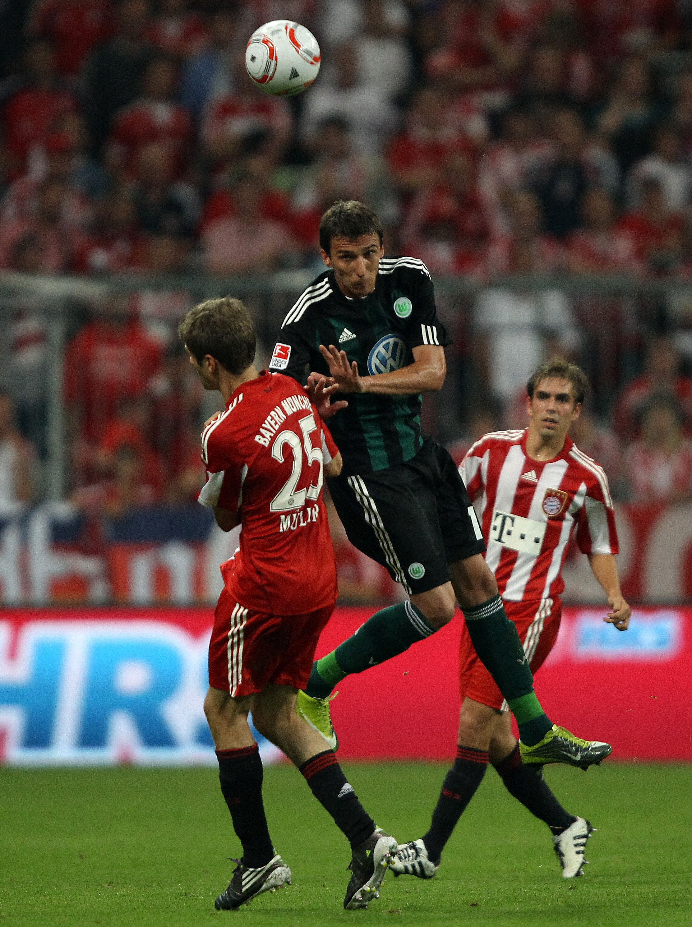 MUNICH, GERMANY - AUGUST 20: Mario Mandzukic of Wolfsburg jumps for a header during the Bundesliga match between FC Bayern Muenchen and VfL Wolfsburg at Allianz Arena on August 20, 2010 in Munich, Germany.  (Photo by Clive Brunskill/Getty Images)