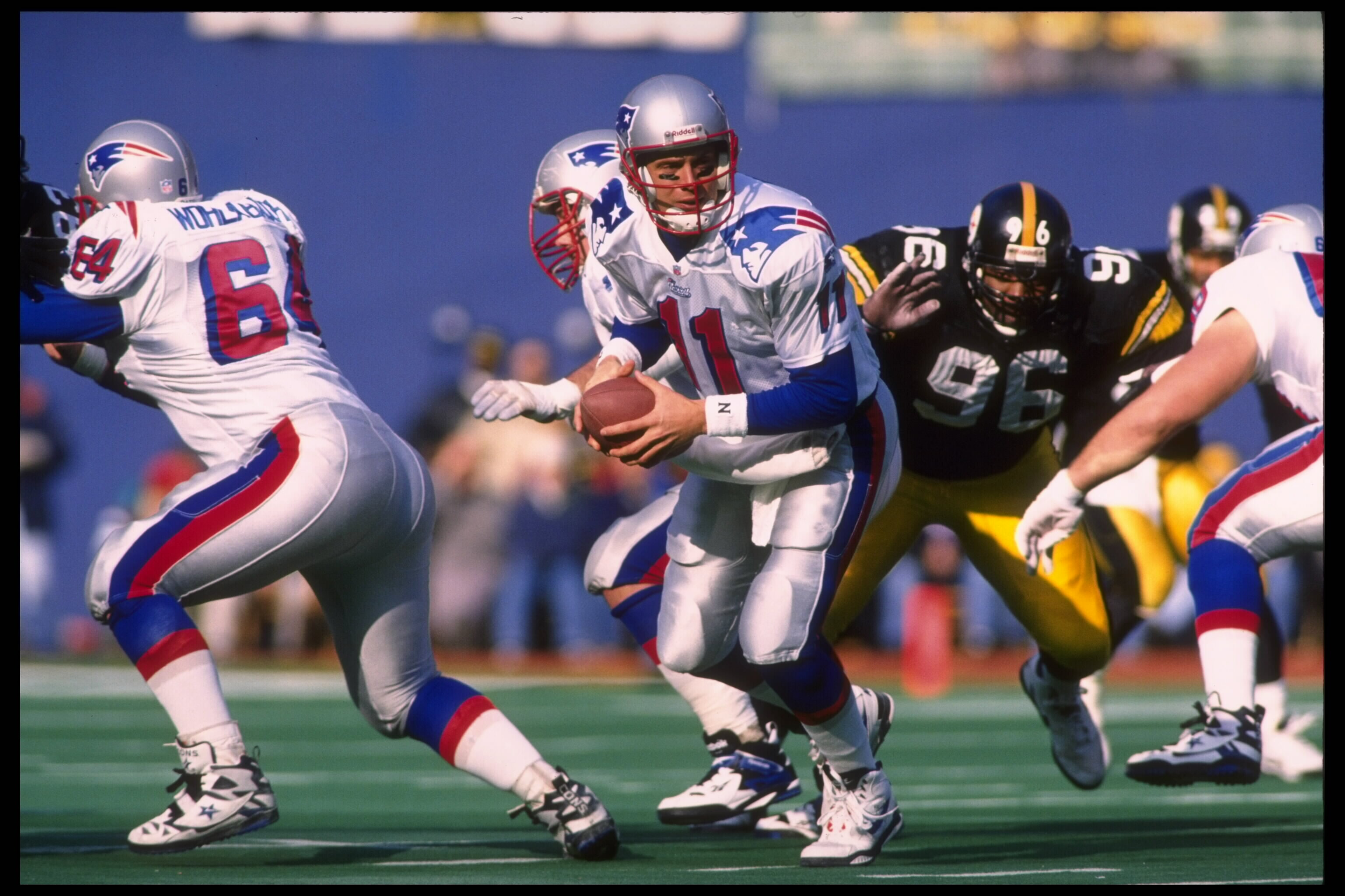 16 Dec 1995:  Quarterback Drew Bledsoe #11 of the New England Patriots drops back to hand off to his running back as Brentson Buckner #96 of the Pittsburgh Steelers comes across the line. The Steelers beat the Patriots 41-27 at Three Rivers Stadium in Pit
