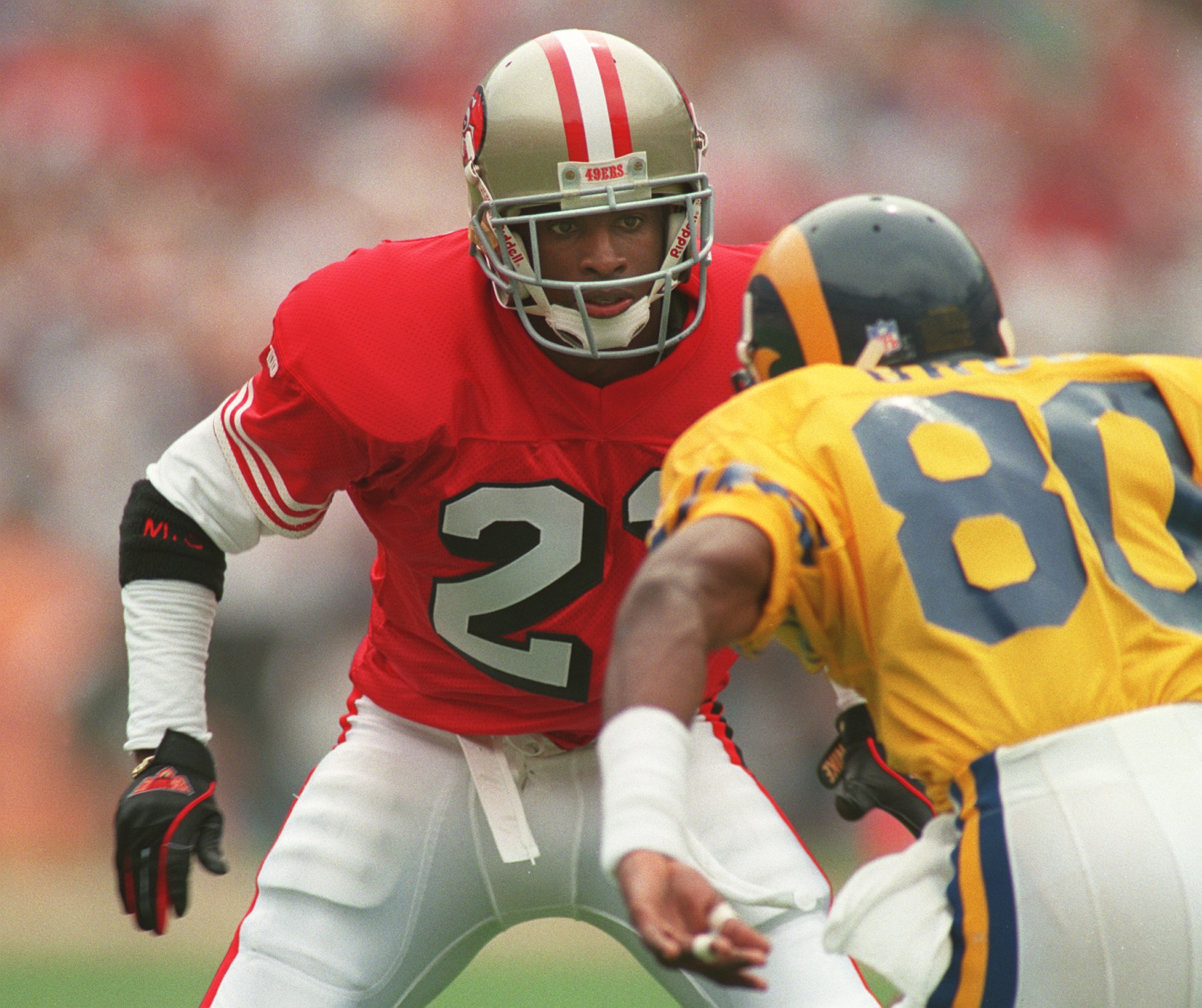 18 SEP 1994:  CORNERBACK DEION SANDERS OF THE SAN FRANCISCO 49ERS DEFENDS AGAINST A RAM''S WIDE RECEIVER DURING THE 49ERS 34-19 WIN AT AT ANAHEIM STADIUM IN CALIFORNIA. Mandatory Credit: Stephen Dunn/ALLSPORT