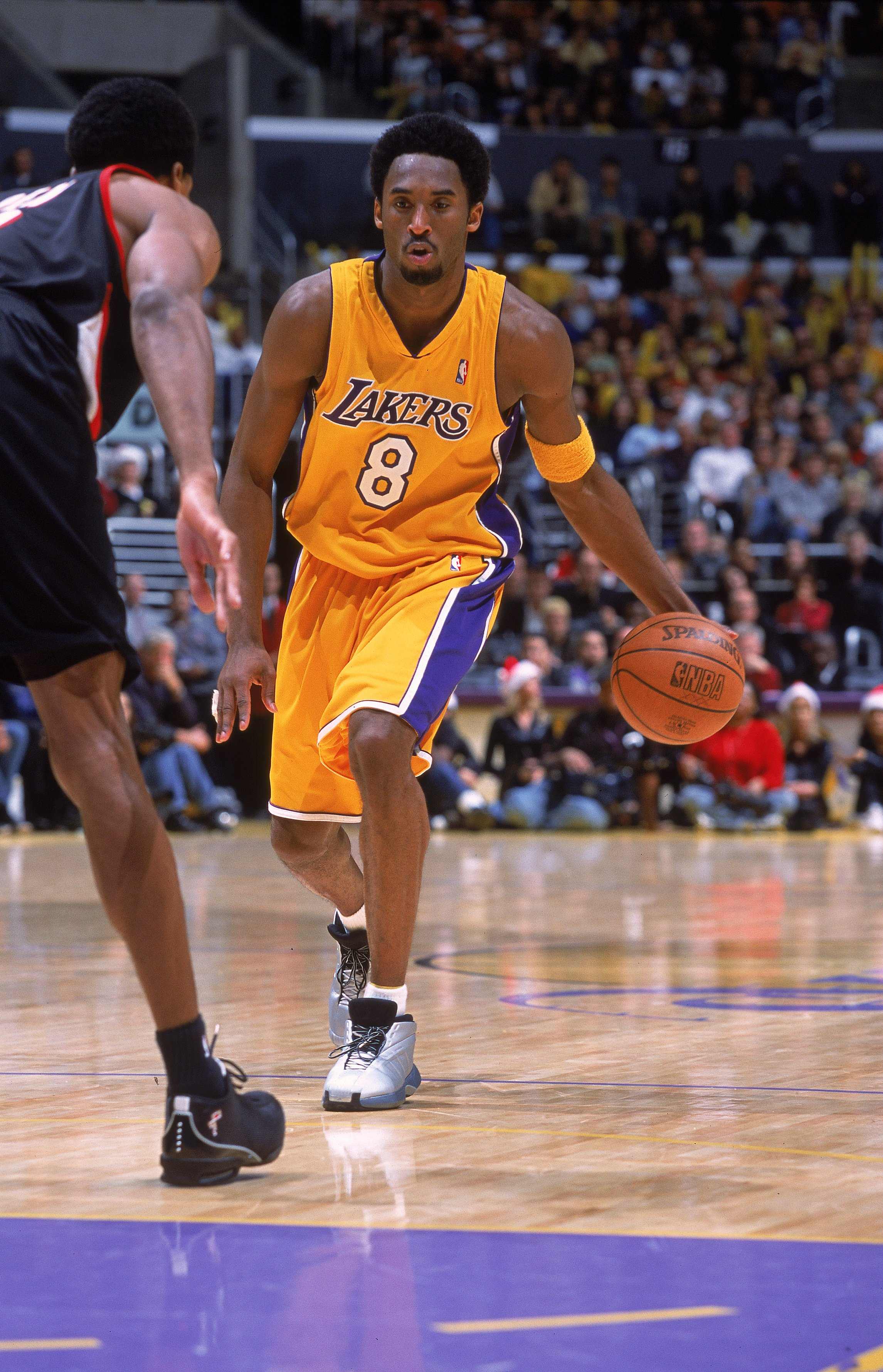 25 Dec 2000:  Kobe Bryant #8 of the Los Angeles Lakers moves with the ball during the game against the Portland Trail Blazers at the STAPLES Center in Los Angeles, California. The Trail Blazers defeated the Lakers 109-104.   NOTE TO USER: It is expressly