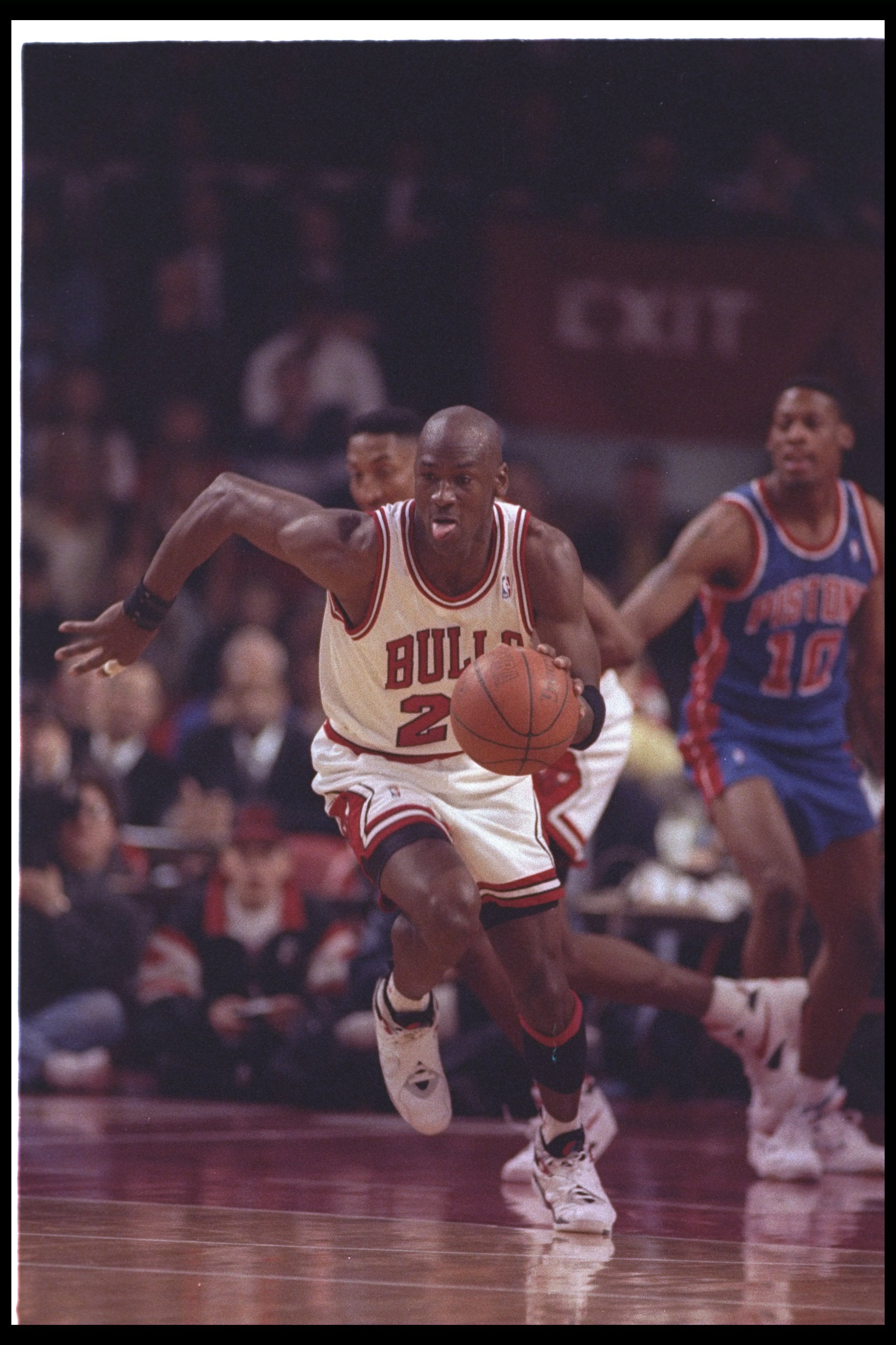 22 Apr 1993:  Guard Michael Jordan #23 of the Chicago Bulls  dribbles the ball hard up the court on a fast break during a game against the Detroit Pistons at the United Center in Chicago, Illinois.  Dennis Rodman from the Detroit Pistons is watching in th