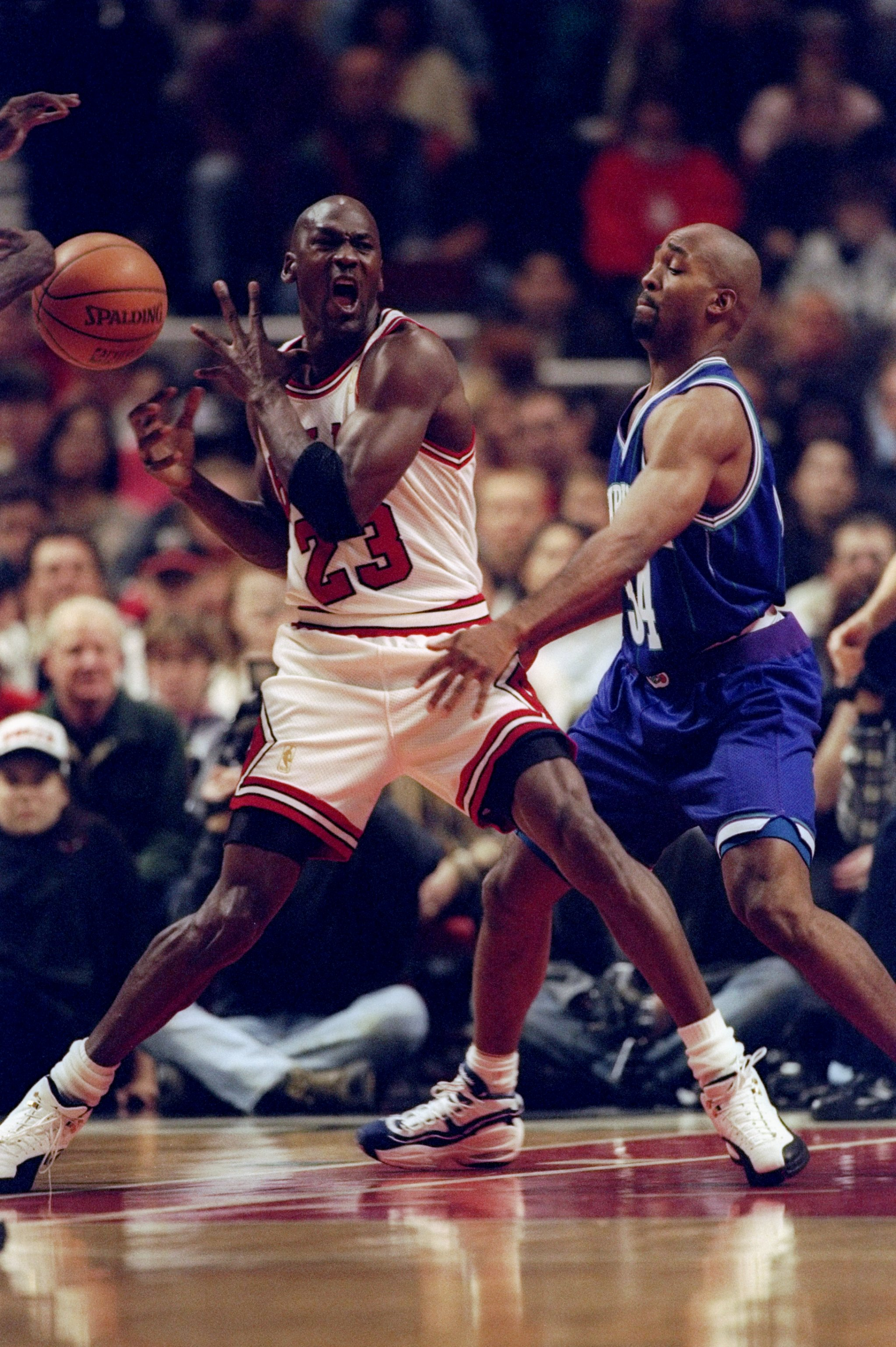 14 Dec 1996:  Guard Michael Jordan of the Chicago Bulls (left) moves the ball as Charlotte Hornets guard Tony Smith covers him during a game at the United Center in Chicago, Illinois.  The Bulls won the game, 87-82. Mandatory Credit: Jonathan Daniel  /All