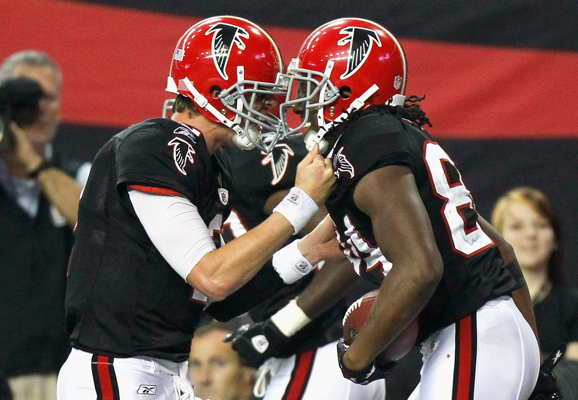 ATLANTA - NOVEMBER 11:  Quarterback Matt Ryan #2 and Roddy White #84 of the Atlanta Falcons react after White's touchdown reception in the final seconds against the Baltimore Ravens at Georgia Dome on November 11, 2010 in Atlanta, Georgia.  (Photo by Kevi