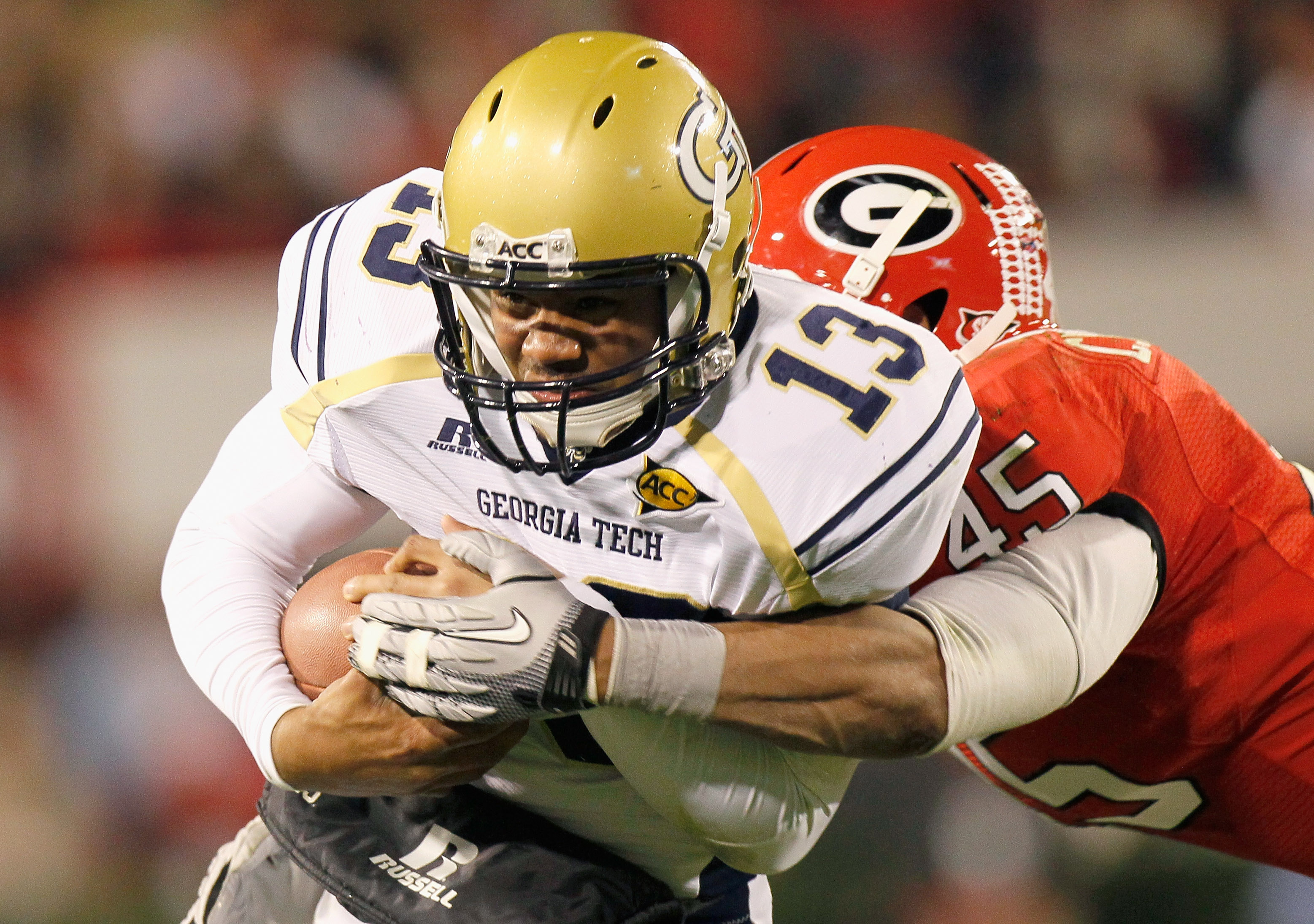 ATHENS, GA - NOVEMBER 27:  Quarterback Tevin Washington #13 of the Georgia Tech Yellow Jackets is tackled by Christian Robinson #45 the Georgia Bulldogs at Sanford Stadium on November 27, 2010 in Athens, Georgia.  (Photo by Kevin C. Cox/Getty Images)