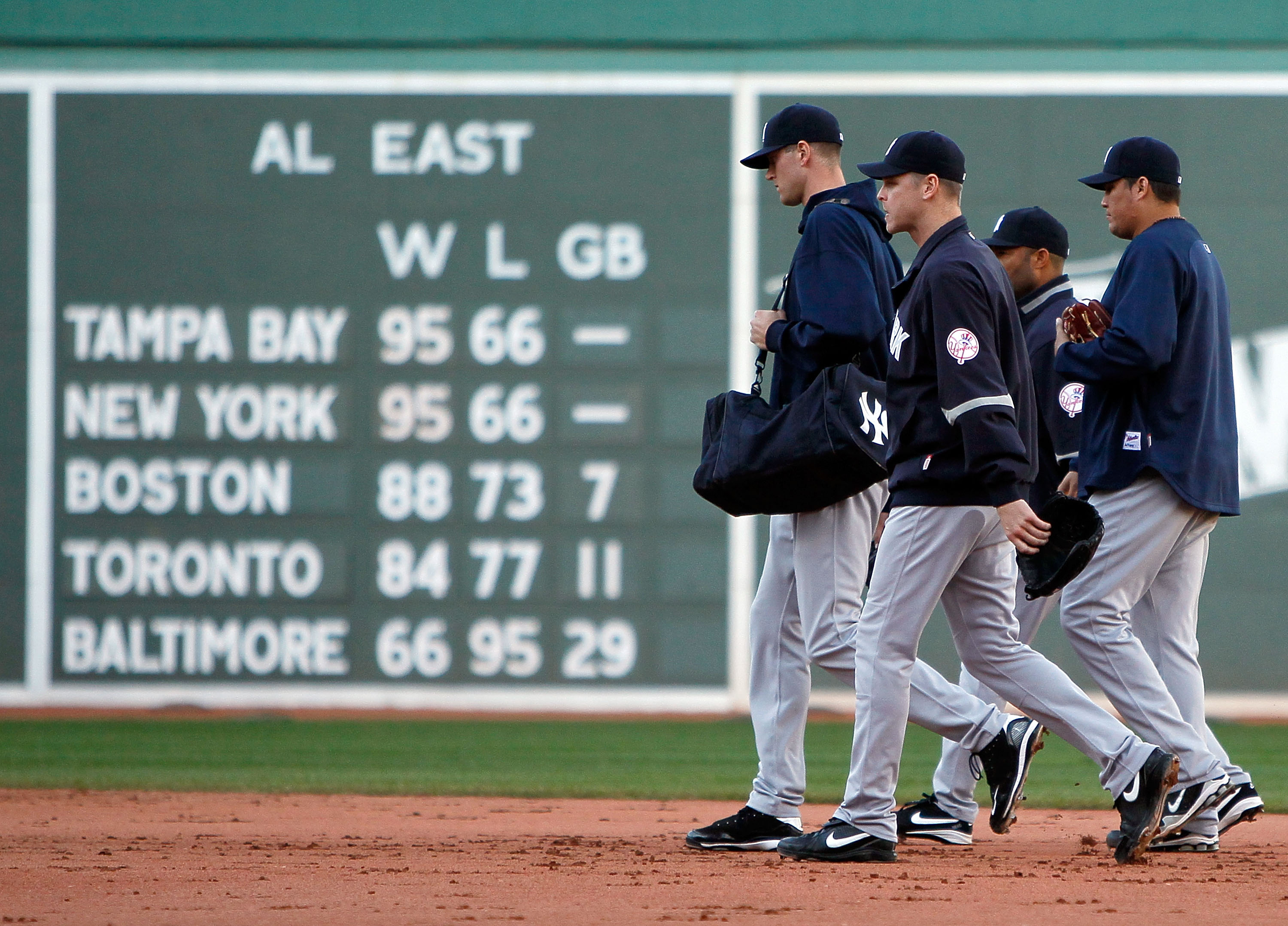 58a1d642d1e BOSTON - OCTOBER 3  Members of the New York Yankees bullpen walk off of the