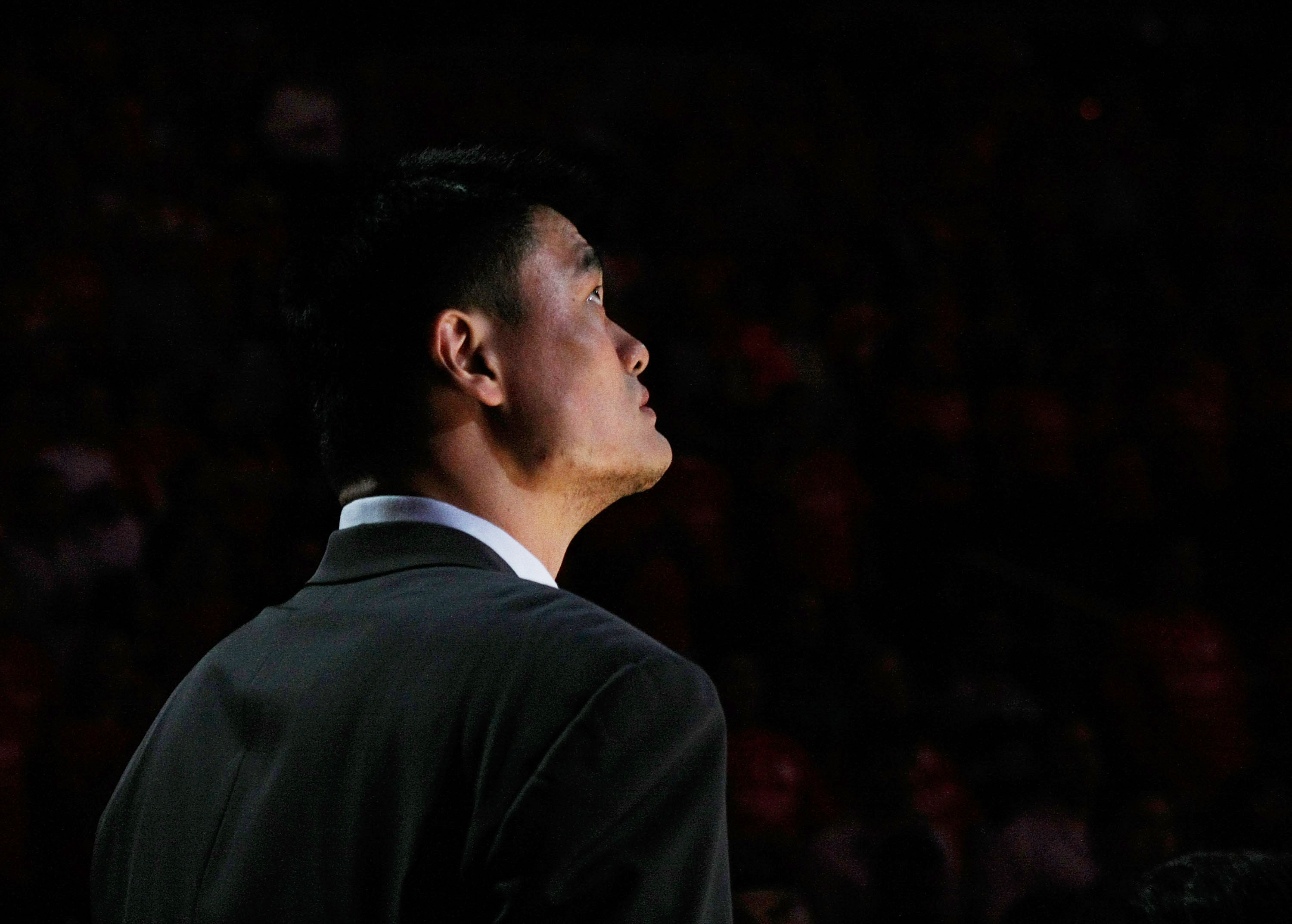 HOUSTON - APRIL 19:  Injured center Yao Ming #11 of the Houston Rockets watches pregame introductions for Game One of the Western Conference Quarterfinals against the Utah Jazz during the 2008 NBA Playoffs at the Toyota Center on April 19, 2008 in Houston