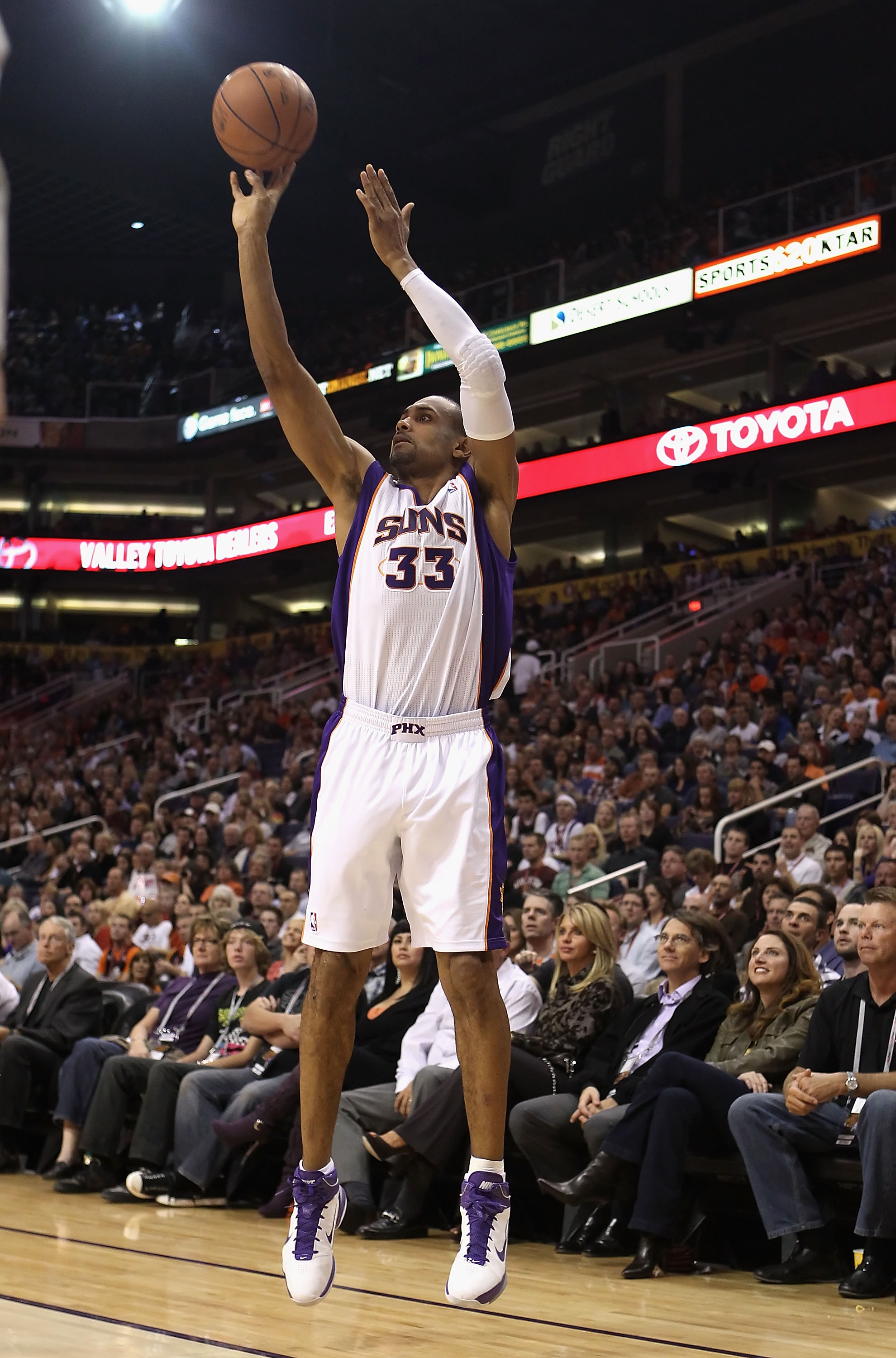 PHOENIX - DECEMBER 10:  Grant Hill #33 of the Phoenix Suns puts up a shot during the NBA game against the Portland Trail Blazers at US Airways Center on December 10, 2010 in Phoenix, Arizona. The Trail Blazers defeated the Suns 101-94.  NOTE TO USER: User