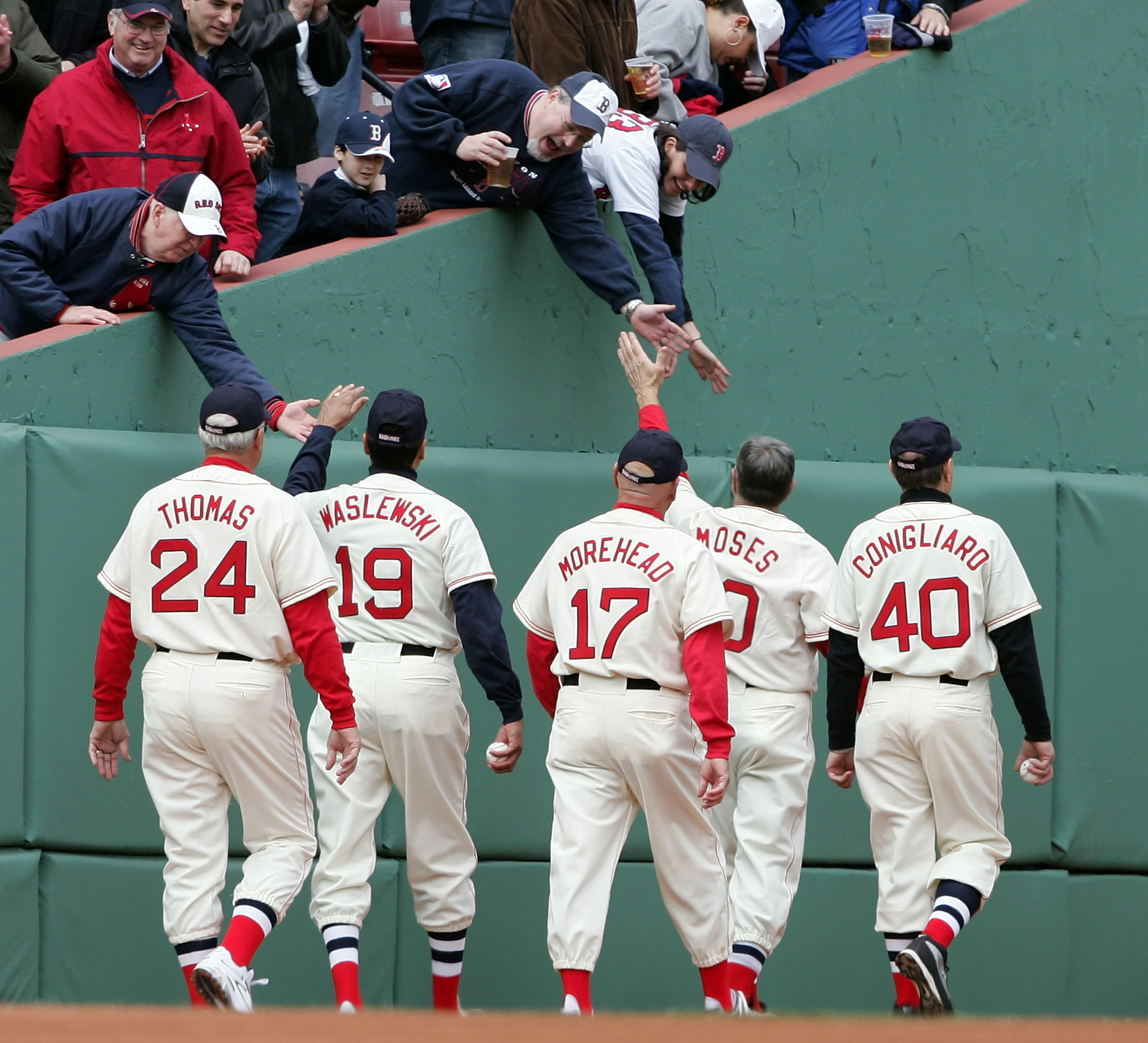 BOSTON - APRIL 10: George Thomas #24, Gary Waslewski #19, Dave Morehead #17, Jerry Moses #10 and Tony Conigliaro #40 of the 1967 Boston Red Sox walk off the field before the 2007 Red Sox were to take on the Seattle Mariners on opening day at Fenway Park o