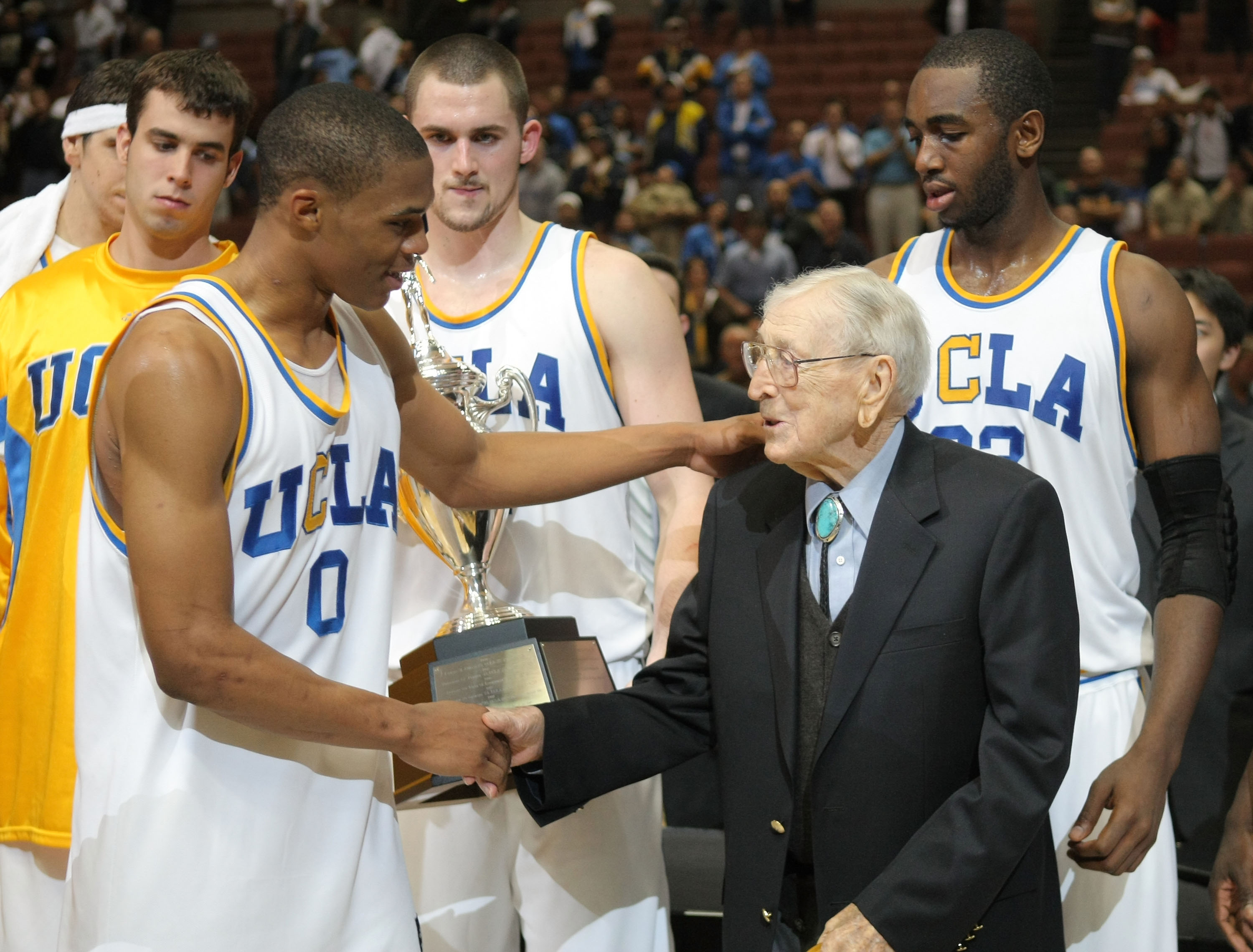 ANAHEIM, CA - DECEMBER 8:  Russell Westbrook #0 of the UCLA Bruins shakes hands with former college basketball coach John Wooden after a 75-63 win over the Davidson Wildcats during the John Wooden Classic at the Honda Center December 8, 2007 in Anaheim, C