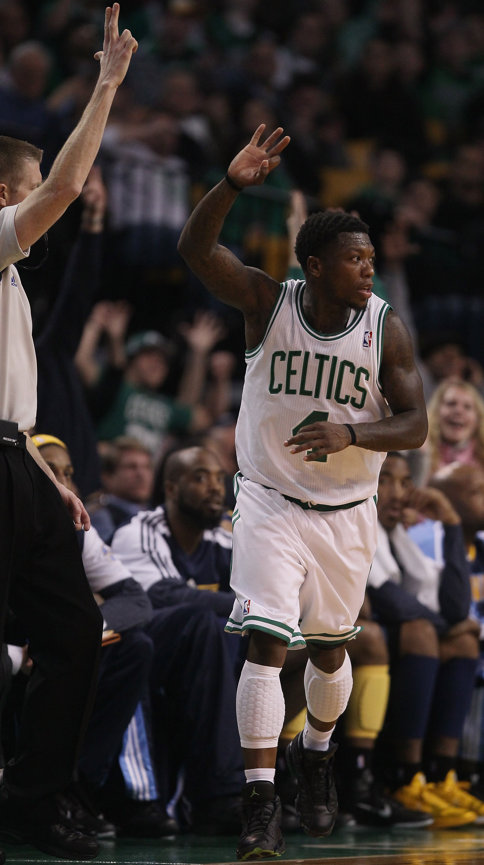 BOSTON, MA - DECEMBER 08:  Nate Robinson #4 of the Boston Celtics celebrates his three point basket in the second half against the Denver Nuggets on December 8, 2010 at the TD Garden in Boston, Massachusetts. The Celtics defeated the Nuggets 105-89. NOTE