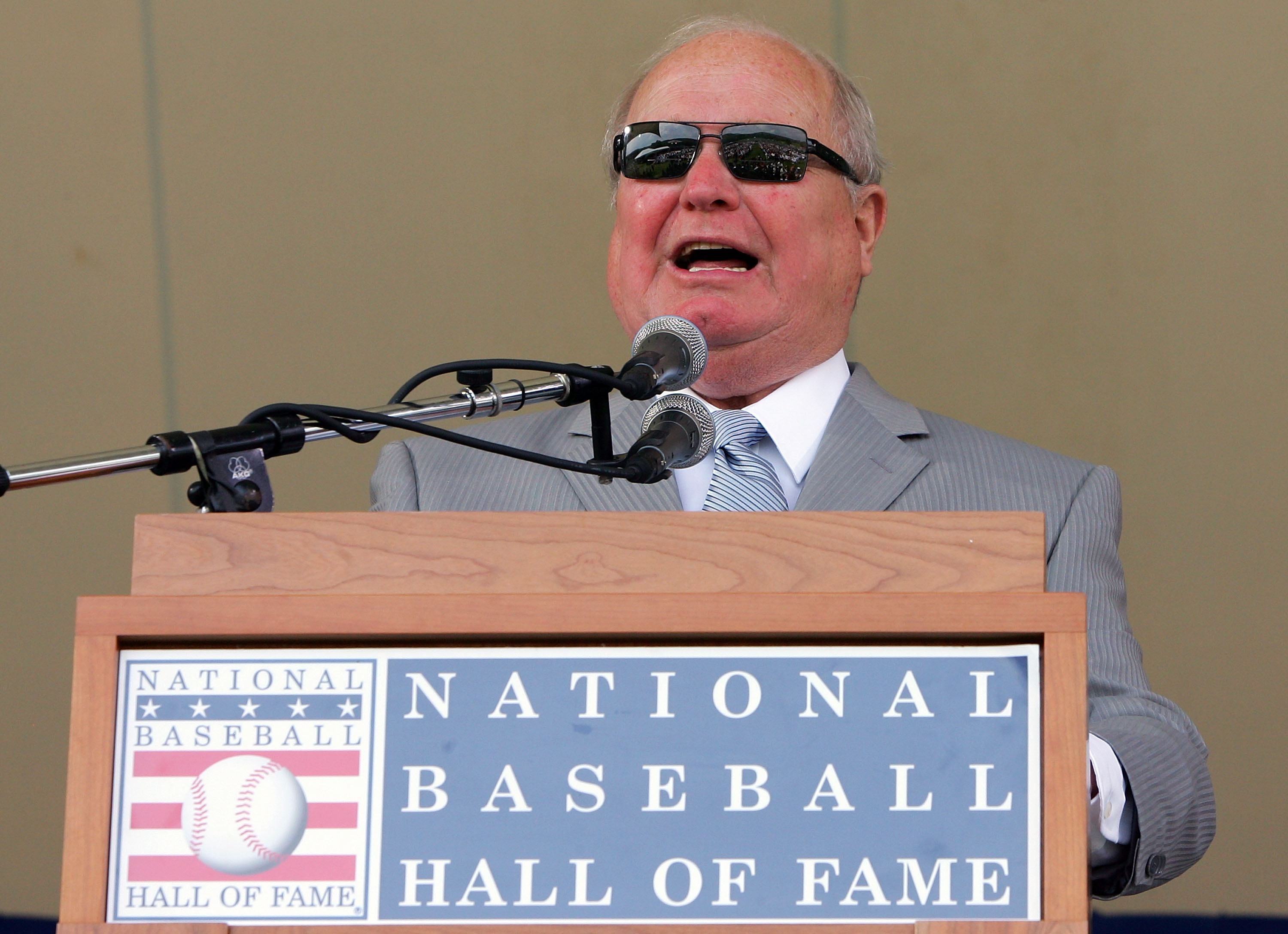 COOPERSTOWN, NY - JULY 27:  Dave Niehaus gives a speech after accepting the Ford C. Frick award for excellence in broadcasting at Clark Sports Center during the Baseball Hall of Fame induction ceremony on July 27, 2008 in Cooperstown, New York.  (Photo by