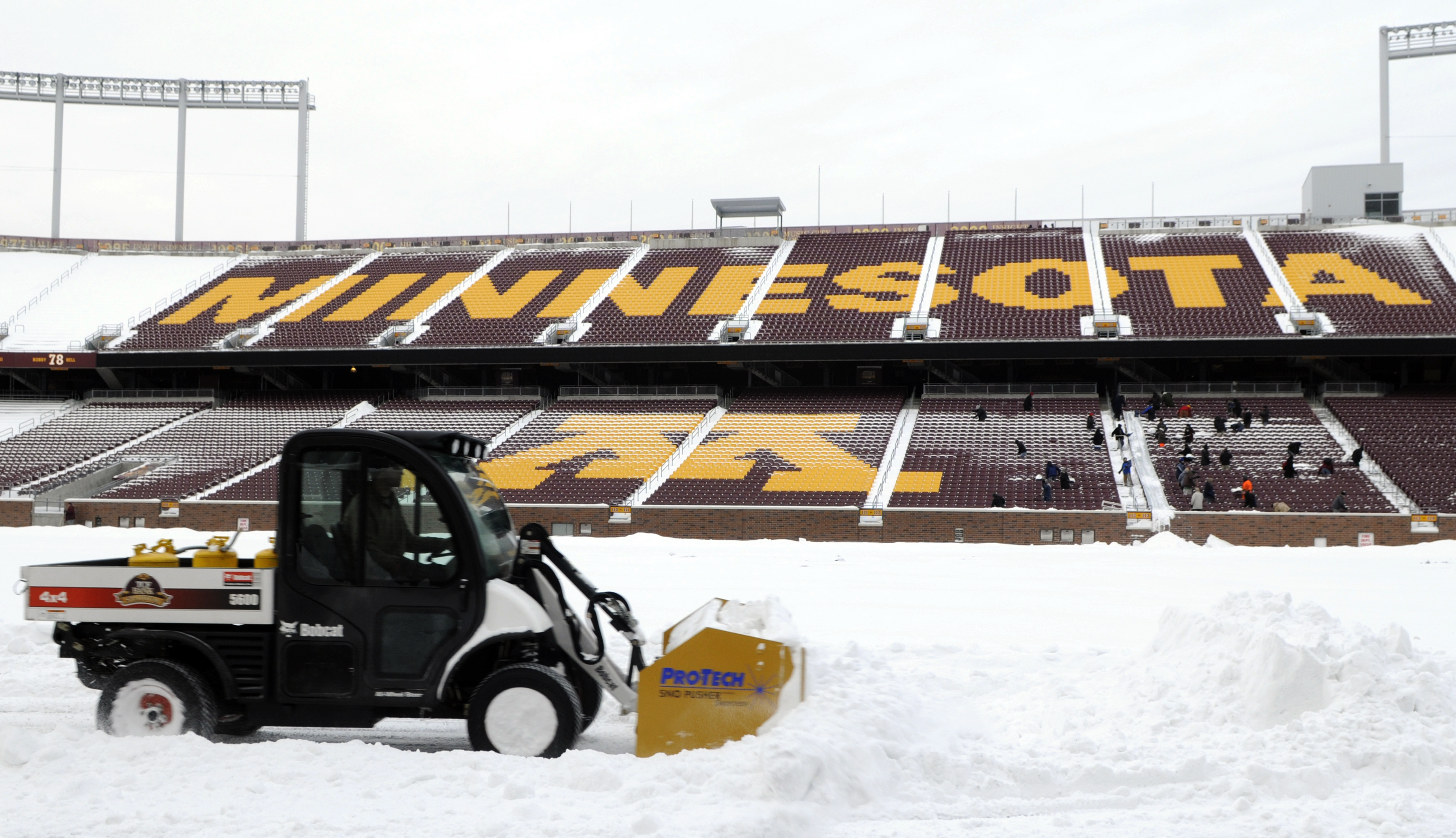 MINNEAPOLIS, MN - DECEMBER 15: Heavy machinery moves snow on the field as TCF Bank Stadium prepares for a potential monday night football game between the Minnesota Vikings and Chicago Bears on December 15, 2010 in Minneapolis, Minnesota. Preparations are