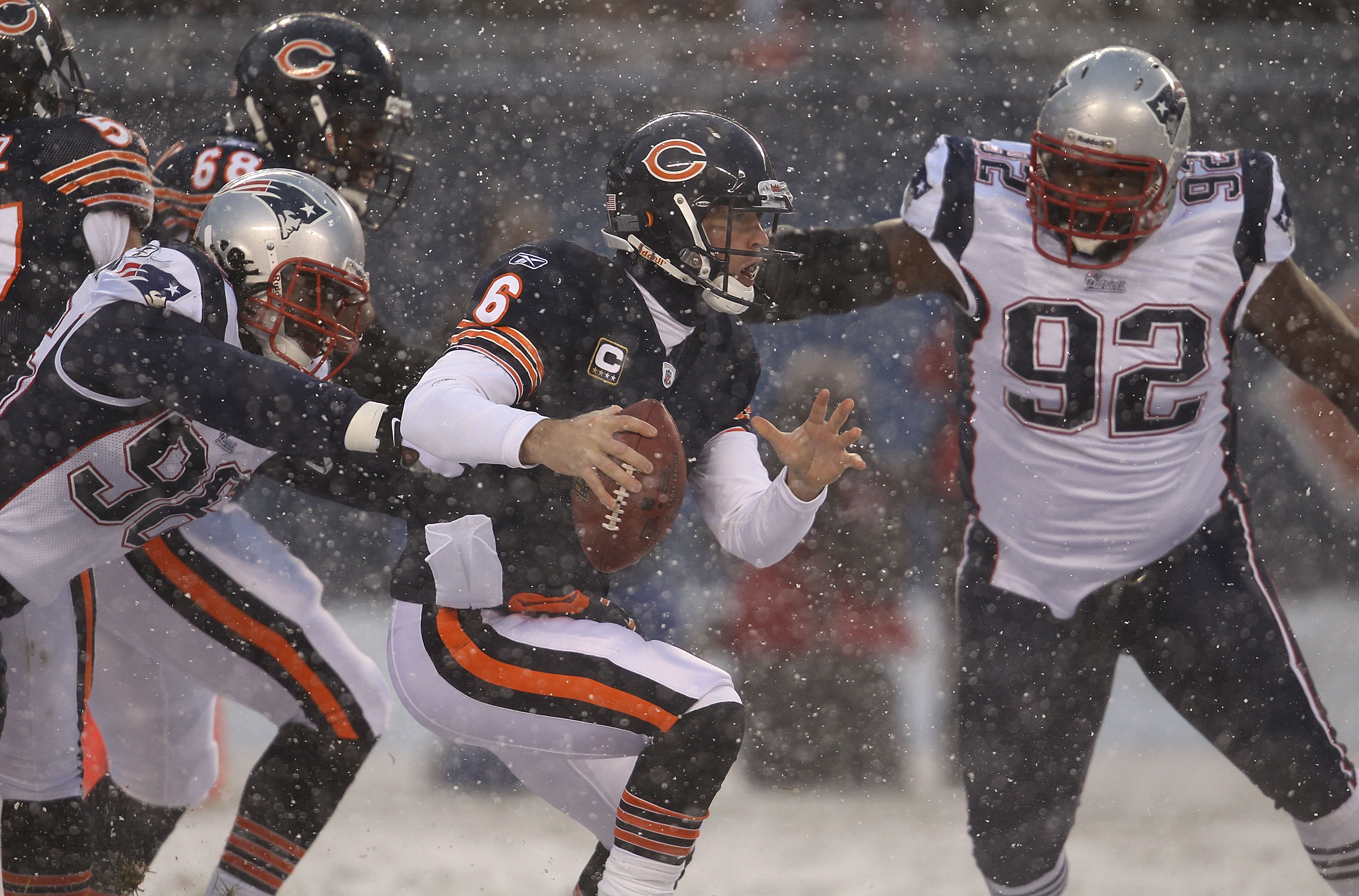 CHICAGO, IL - DECEMBER 12: Jay Cutler #6 of the Chicago Bears tries to avoid Eric Moore #98 and Gerard Warren #92 of the New England Patriots at Soldier Field on December 12, 2010 in Chicago, Illinois.  The Patriots defeated the Bears 36-7.  (Photo by Jon