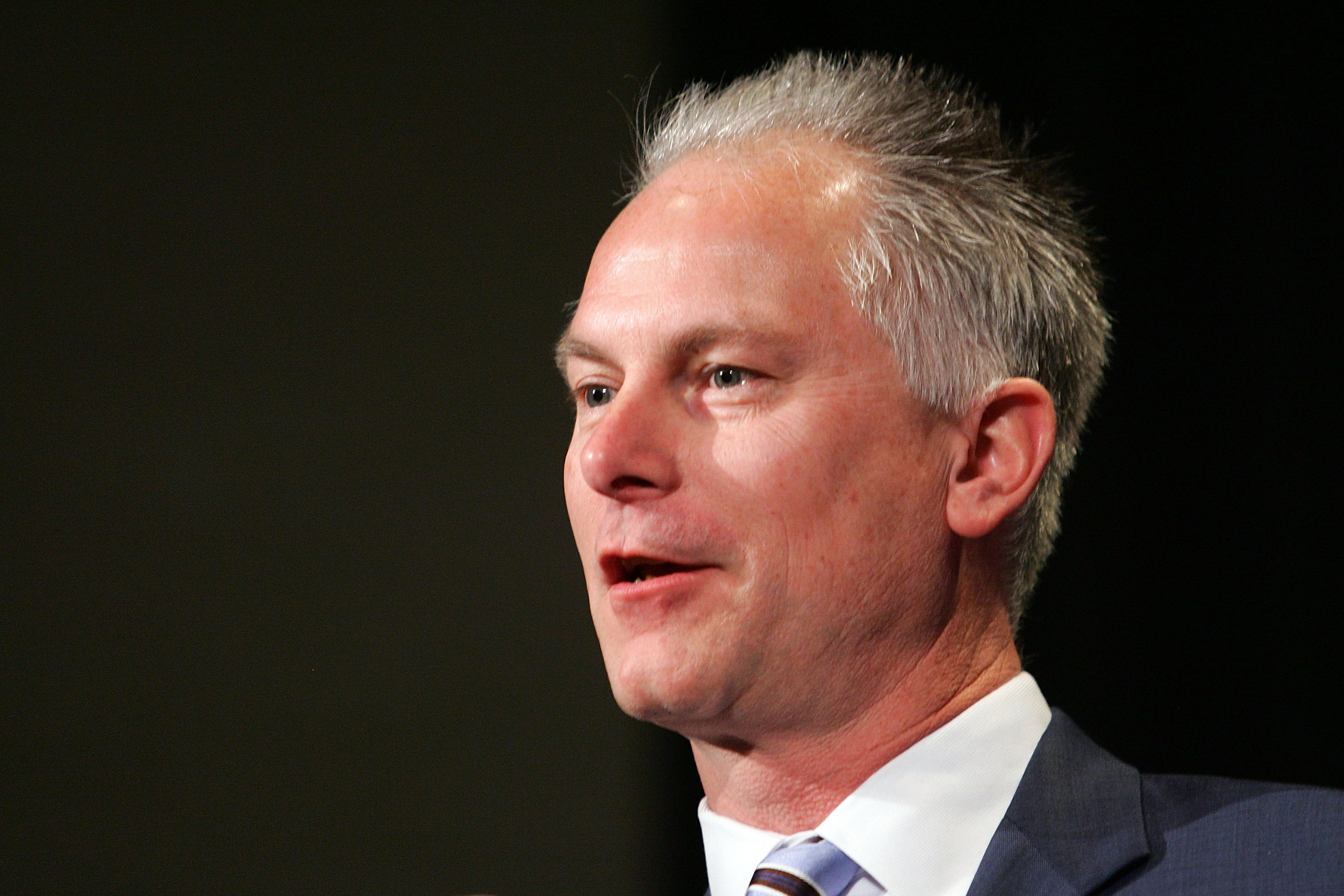 PHOENIX - JANUARY 31:  Kenny Mayne of ESPN asks a question during the GMC Defensive Player of the Year award news conference prior to Super Bowl XLII at the Phoenix Convention Center on January 31, 2008 in Phoenix, Arizona.  (Photo by Streeter Lecka/Getty