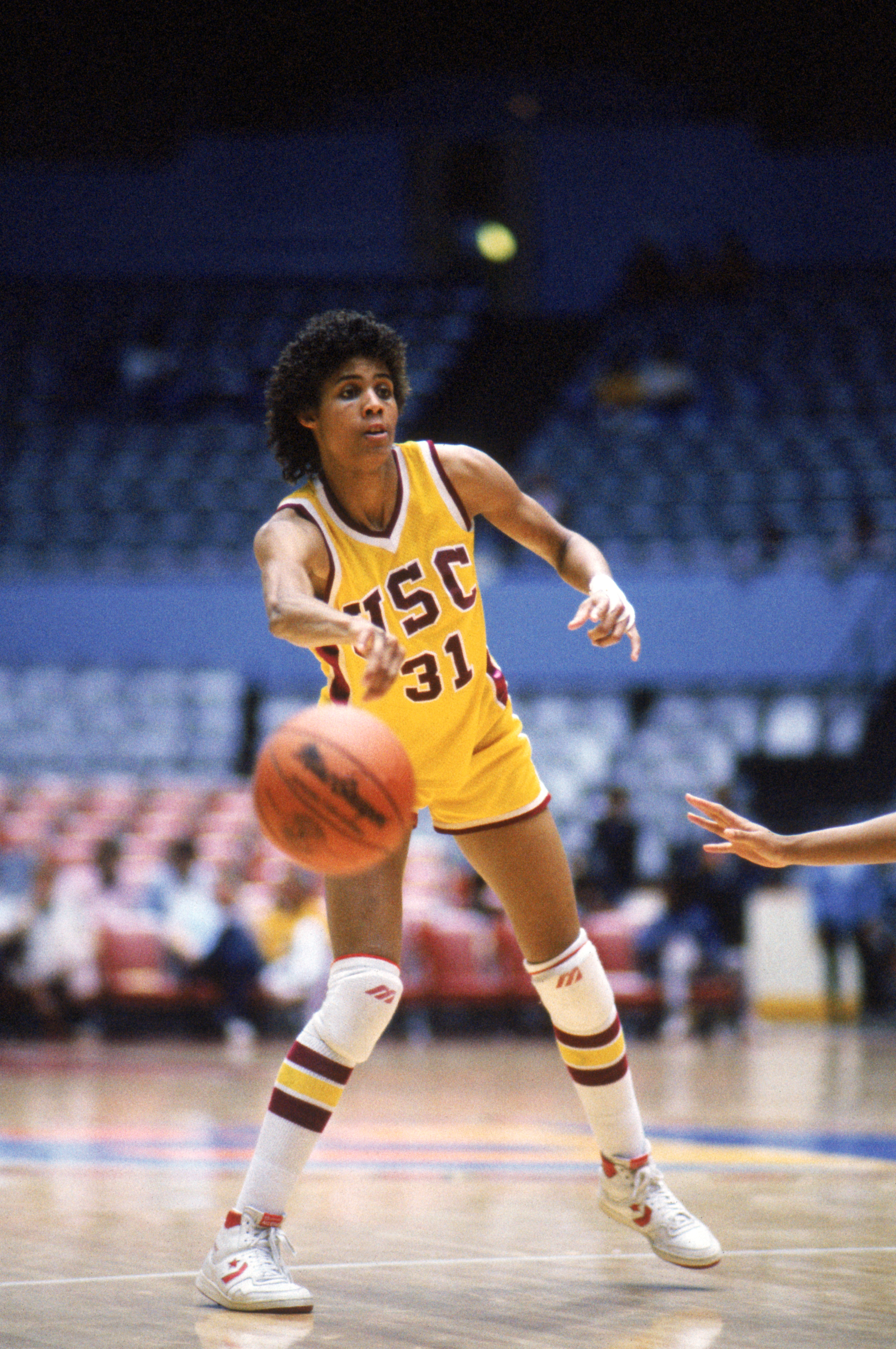 PALO ALTO, CA - Cheryl Miller #31 of USC Trojans passes the ball during a women basketball game against the Stanford Cardinal in Palo Alto, California. Cheryl Miller's college career lasted from 1983-1986. (Photo by: Mike Powell/Getty Images)