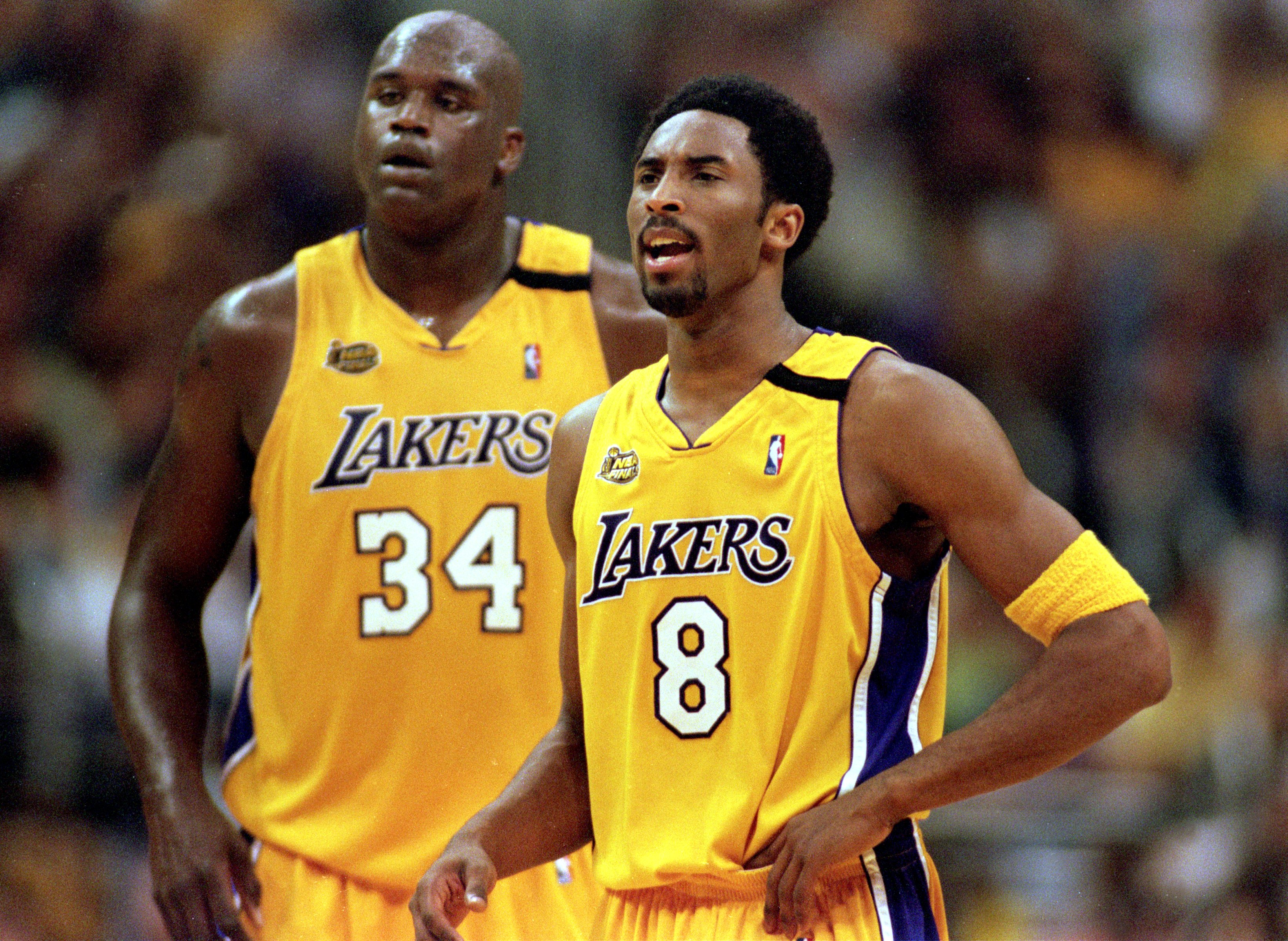19 Jun 2000:  Kobe Bryant #8 and Shaquille O''Neal #34 of the Los Angeles Lakers looking on during the NBA Finals Game 6 against the Indiana Pacers at the Staples Center in Los Angeles, California.  The Lakers defeated the Pacers in 116-111.  NOTE TO USER