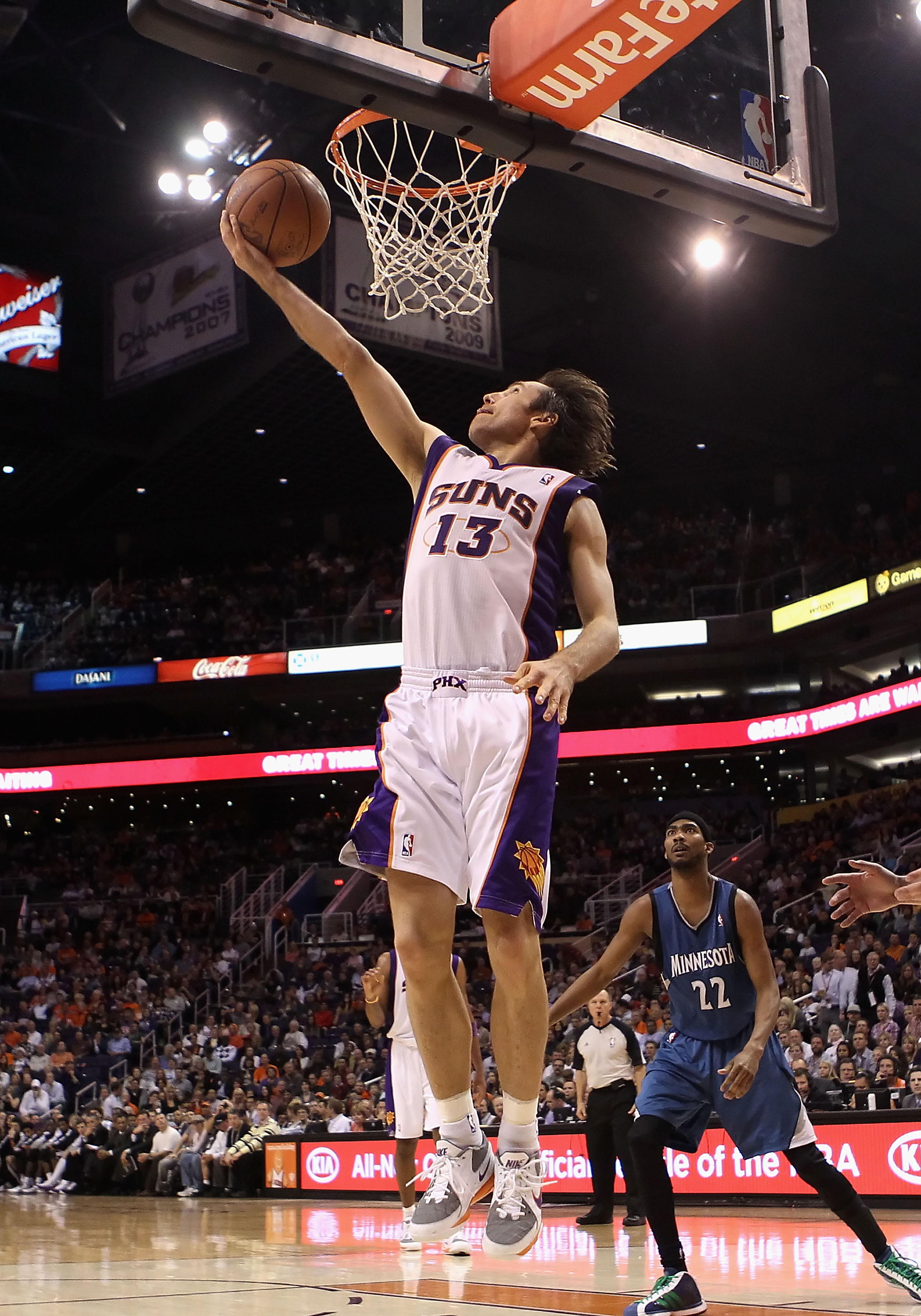 PHOENIX - DECEMBER 15:  Steve Nash #13 of the Phoenix Suns lays up a shot against the Minnesota Timberwolves during the NBA game at US Airways Center on December 15, 2010 in Phoenix, Arizona.  The Suns defeated the Timberwolves 128-122.  NOTE TO USER: Use