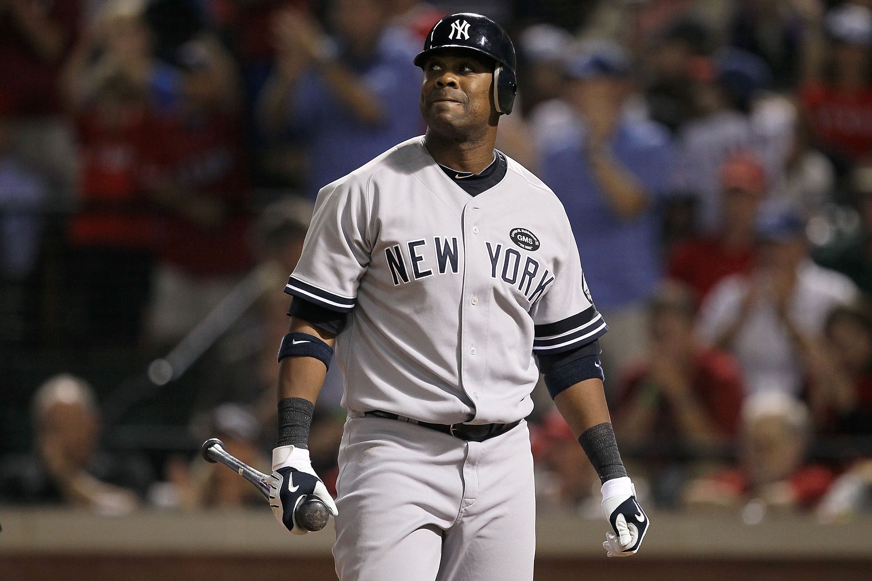 ARLINGTON, TX - OCTOBER 22:  Marcus Thames #38 of the New York Yankees reacts after striking out against the Texas Rangers in Game Six of the ALCS during the 2010 MLB Playoffs at Rangers Ballpark in Arlington on October 22, 2010 in Arlington, Texas.  (Pho
