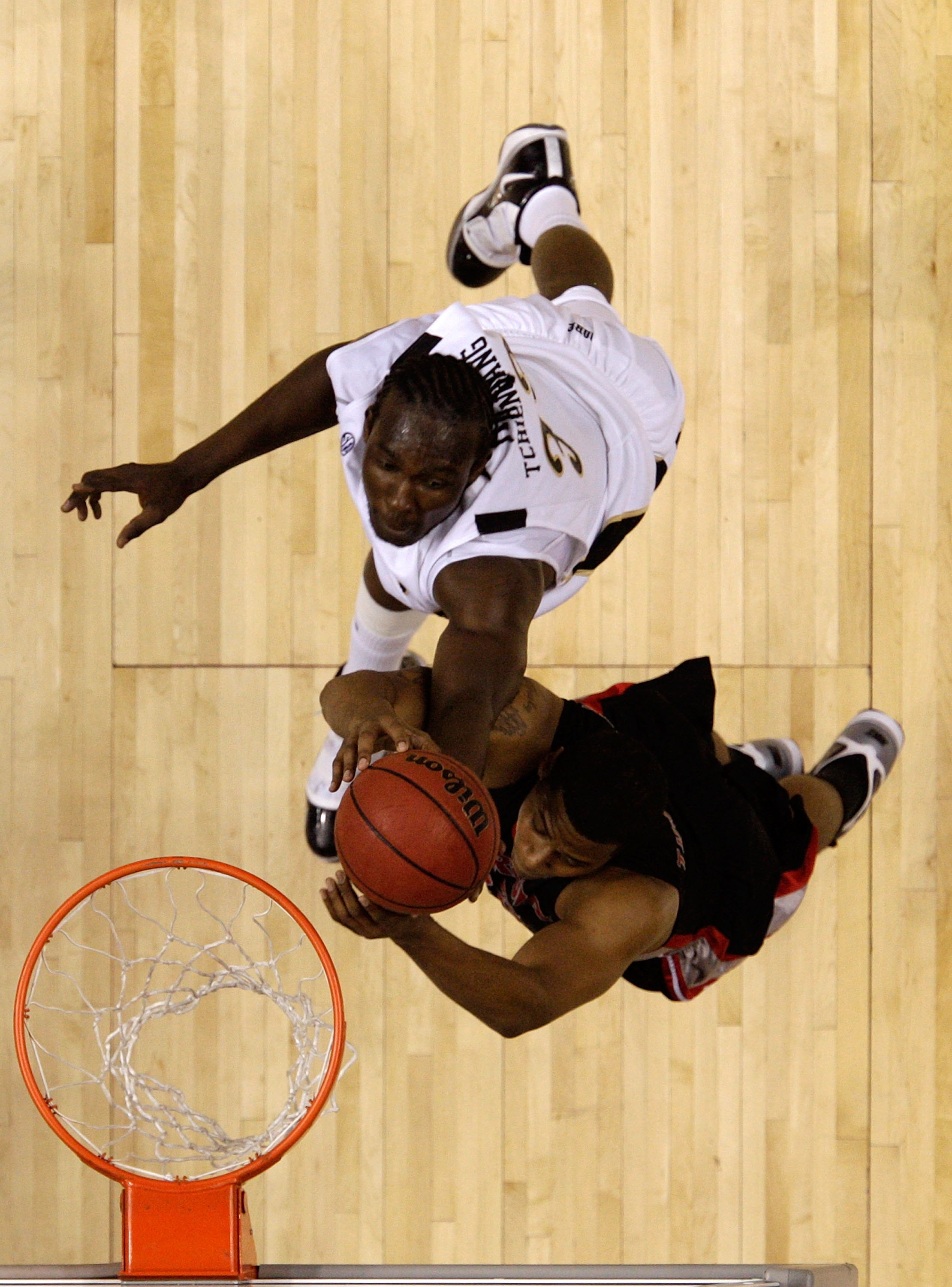 NASHVILLE, TN - MARCH 12:  Steve Tchiengang #33 of the Vanderbilt Commodores fights for a rebound against Trey Thompkins #33 of the Georgia Bulldogs during the quarterfinals of the SEC Men's Basketball Tournament at the Bridgestone Arena on March 12, 2010