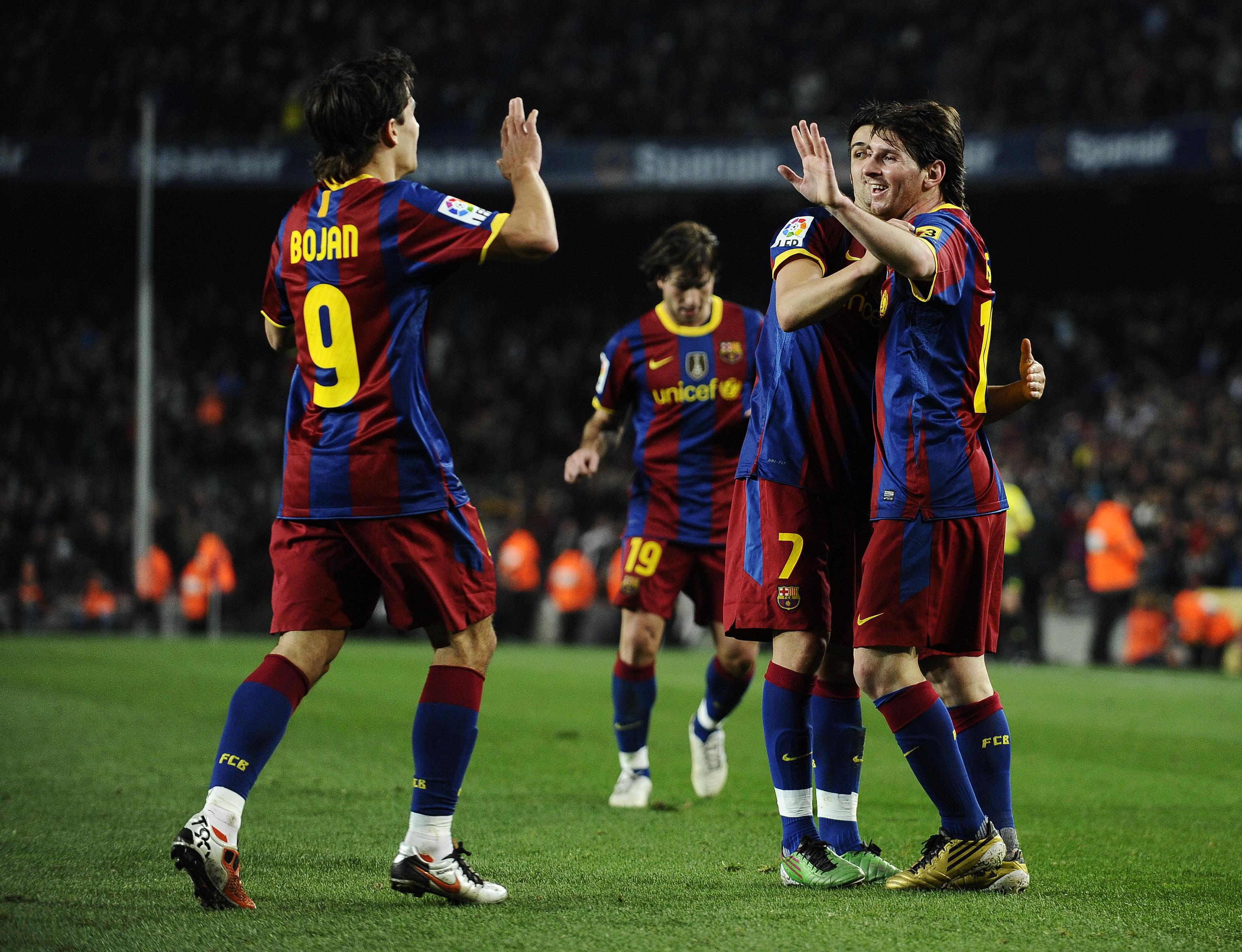 BARCELONA, SPAIN - DECEMBER 12:  Lionel Messi of Barcelona (R), David Villa (2ndR) and Bojan Krkic celebrate after Lionel Messi scored his second goal during the La Liga match between Barcelona and Real Sociedad at Camp Nou Stadium on December 12, 2010 in