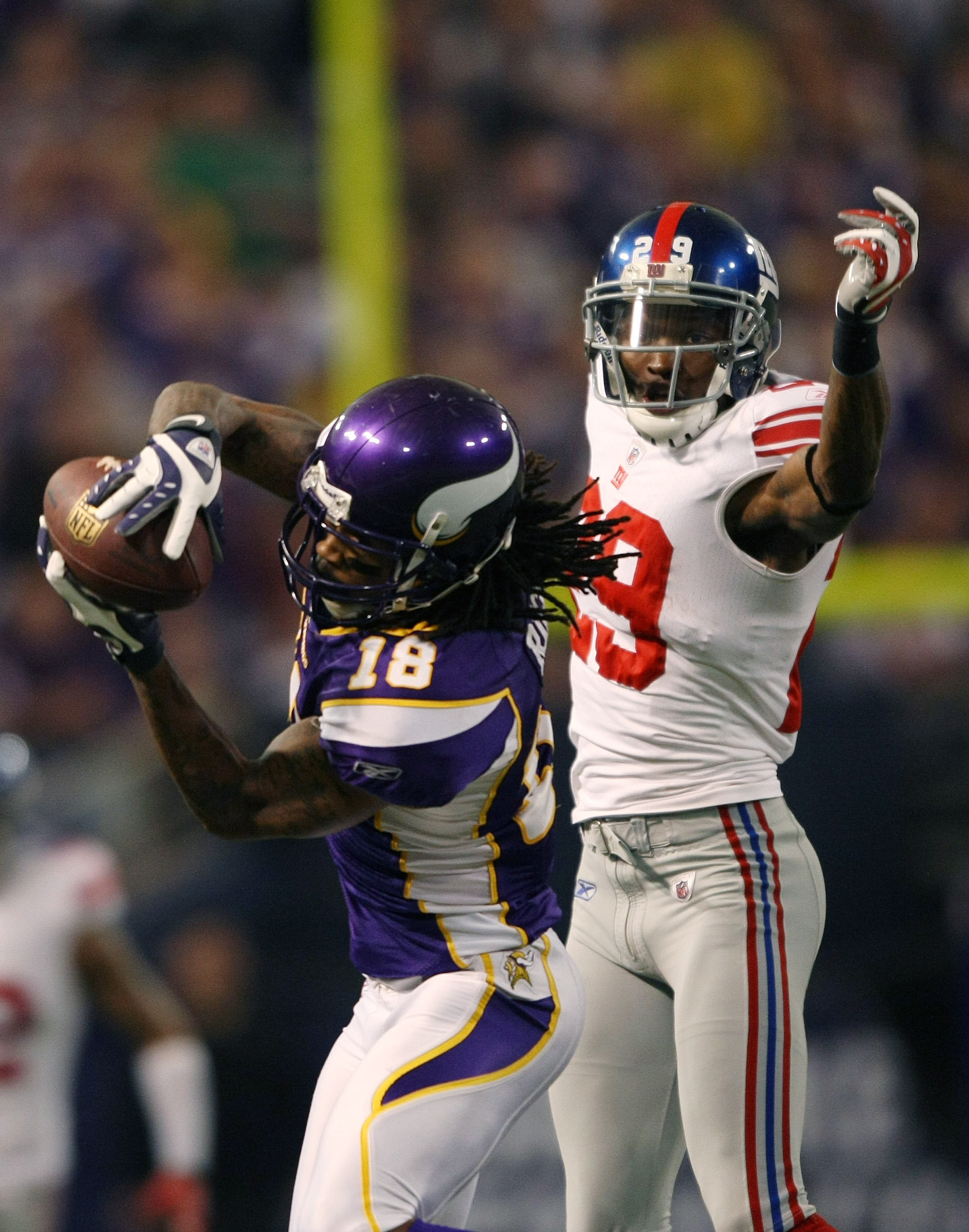 MINNEAPOLIS - JANUARY 03:  Sidney Rice #18 of the Minnesota Vikings makes the catch as D.J. Johnson #29 of the New York Giants defends on January 3, 2010 at Hubert H. Humphrey Metrodome in Minneapolis, Minnesota.  (Photo by Elsa/Getty Images)