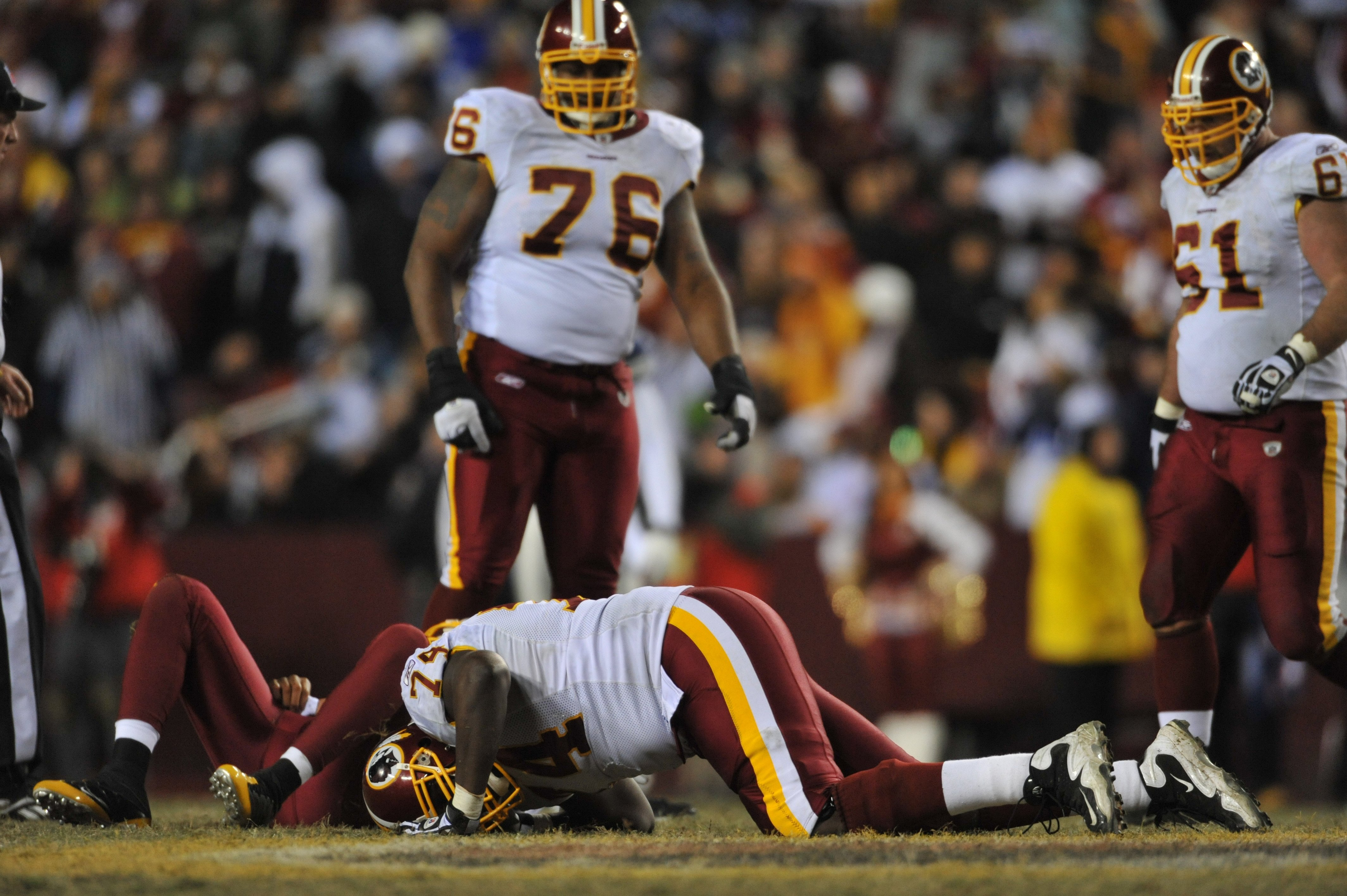 LANDOVER, MD - DECEMBER 27:  Stephon Heyer #74 of the Washington Redskins lies injured during the game against the Dallas Cowboys at FedExField on December 27, 2009 in Landover, Maryland. The Cowboys defeated the Redskins 17-0. (Photo by Larry French/Gett