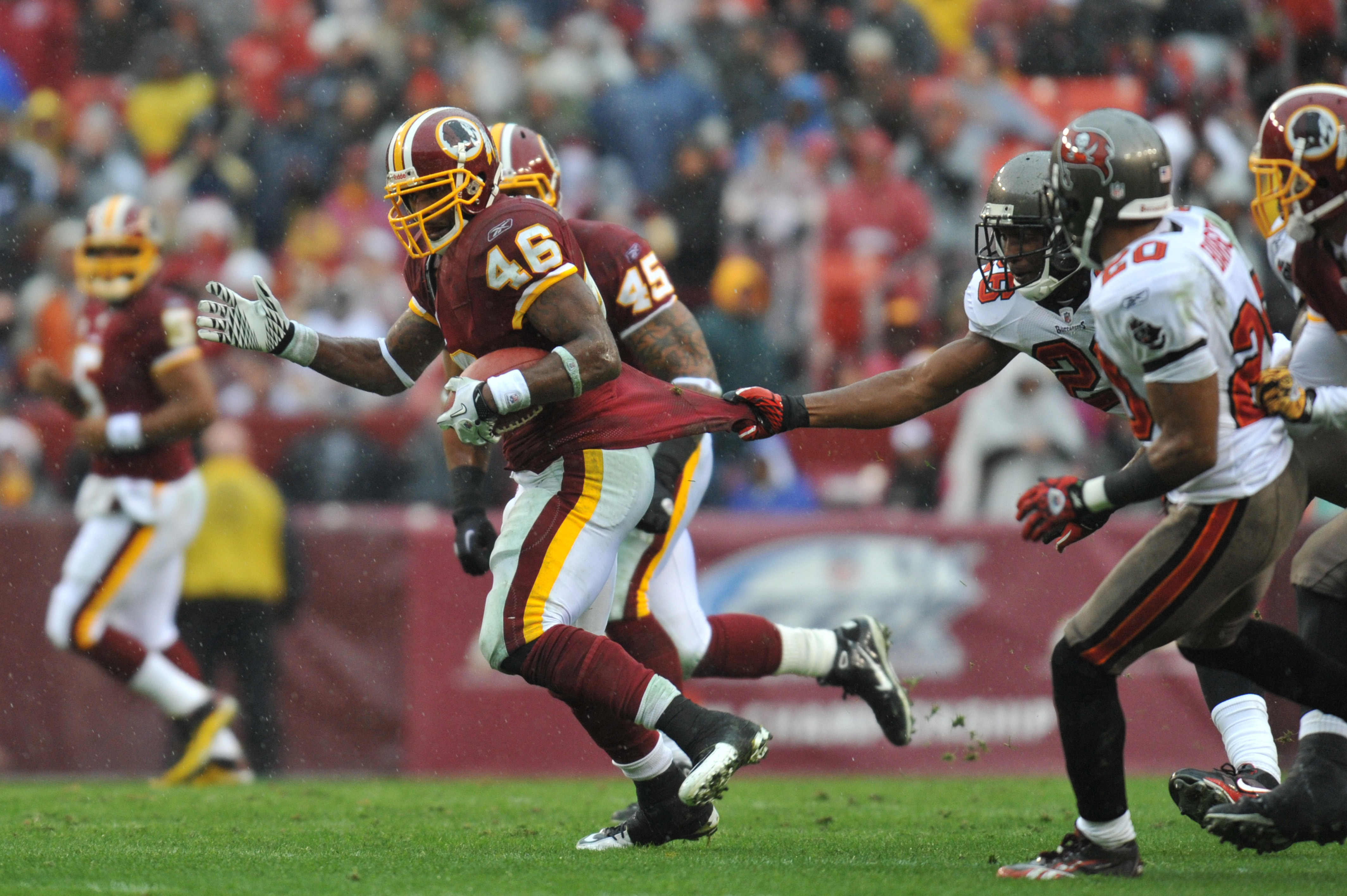 LANDOVER, MD - DECEMBER 12:  Ryan Torain #46 of the Washington Redskins runs the ball against the Tampa Bay Buccaneers  at FedExField on December 12, 2010 in Landover, Maryland. The Buccaneers defeated the Redskins 17-16. (Photo by Larry French/Getty Imag