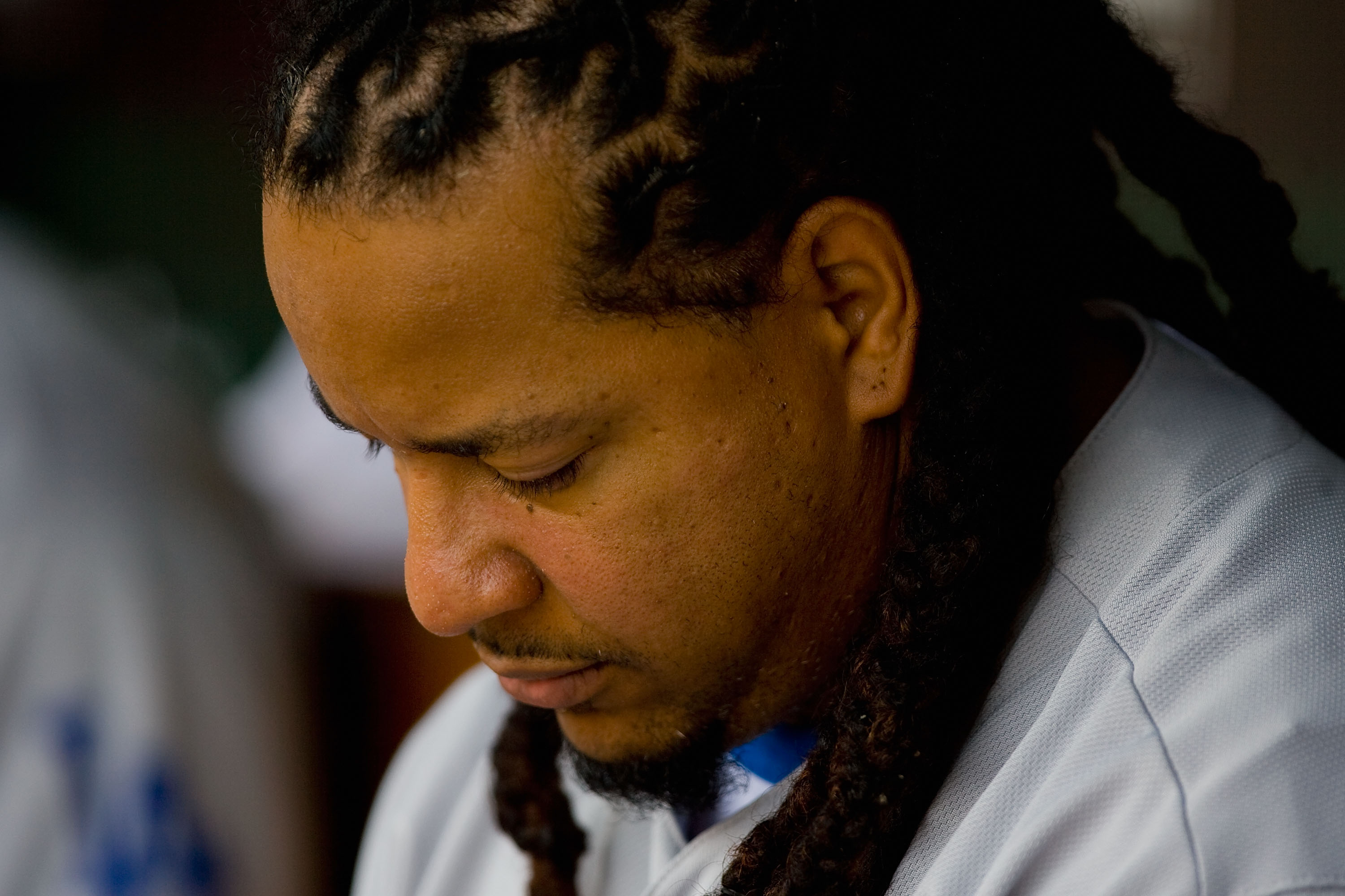 ST. LOUIS - JULY 18: Manny Ramirez #99 of the Los Angeles Dodgers sits in the dugout against the St. Louis Cardinals at Busch Stadium on July 18, 2010 in St. Louis, Missouri.  (Photo by Dilip Vishwanat/Getty Images)