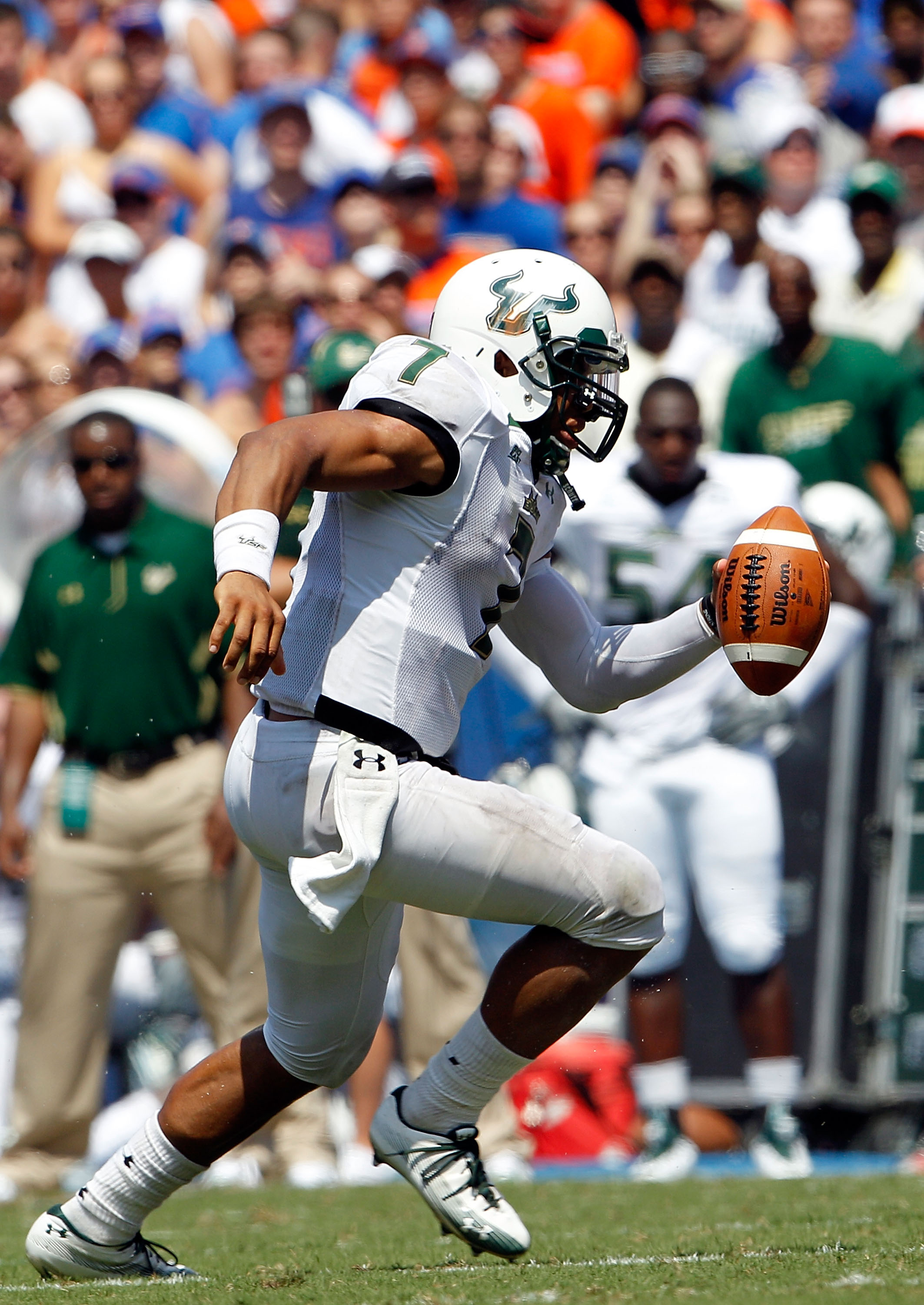 GAINESVILLE, FL - SEPTEMBER 11:  Quarterback B.J. Daniels #7 of the South Florida Bulls runs for yardage during a game against the Florida Gators at Ben Hill Griffin Stadium on September 11, 2010 in Gainesville, Florida.  (Photo by Sam Greenwood/Getty Ima