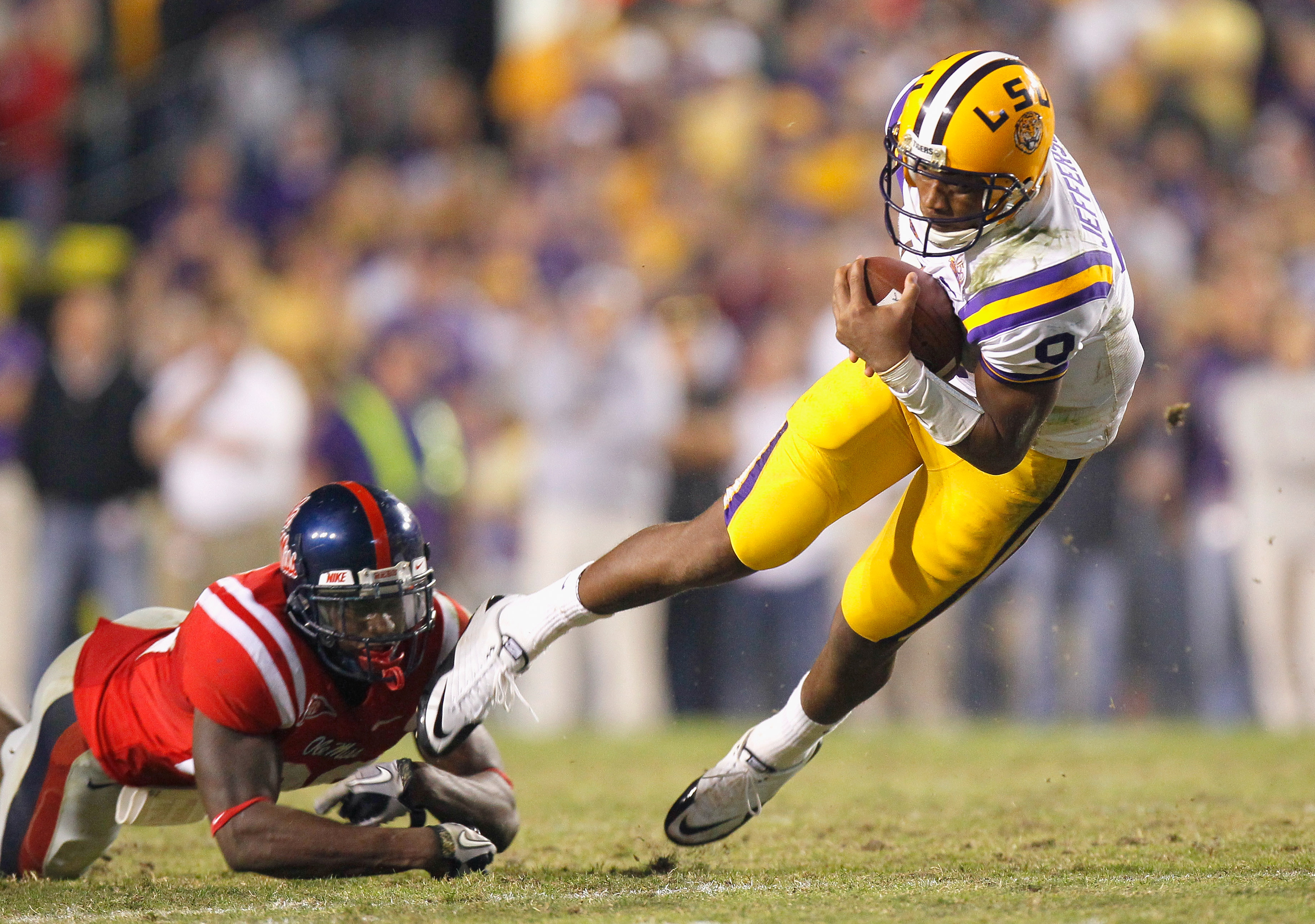 BATON ROUGE, LA - NOVEMBER 20:  Quarterback Jordan Jefferson #9 of the Louisiana State University Tigers is tripped up by Johnny Brown #20 of the Ole Miss Rebels at Tiger Stadium on November 20, 2010 in Baton Rouge, Louisiana.  (Photo by Kevin C. Cox/Gett