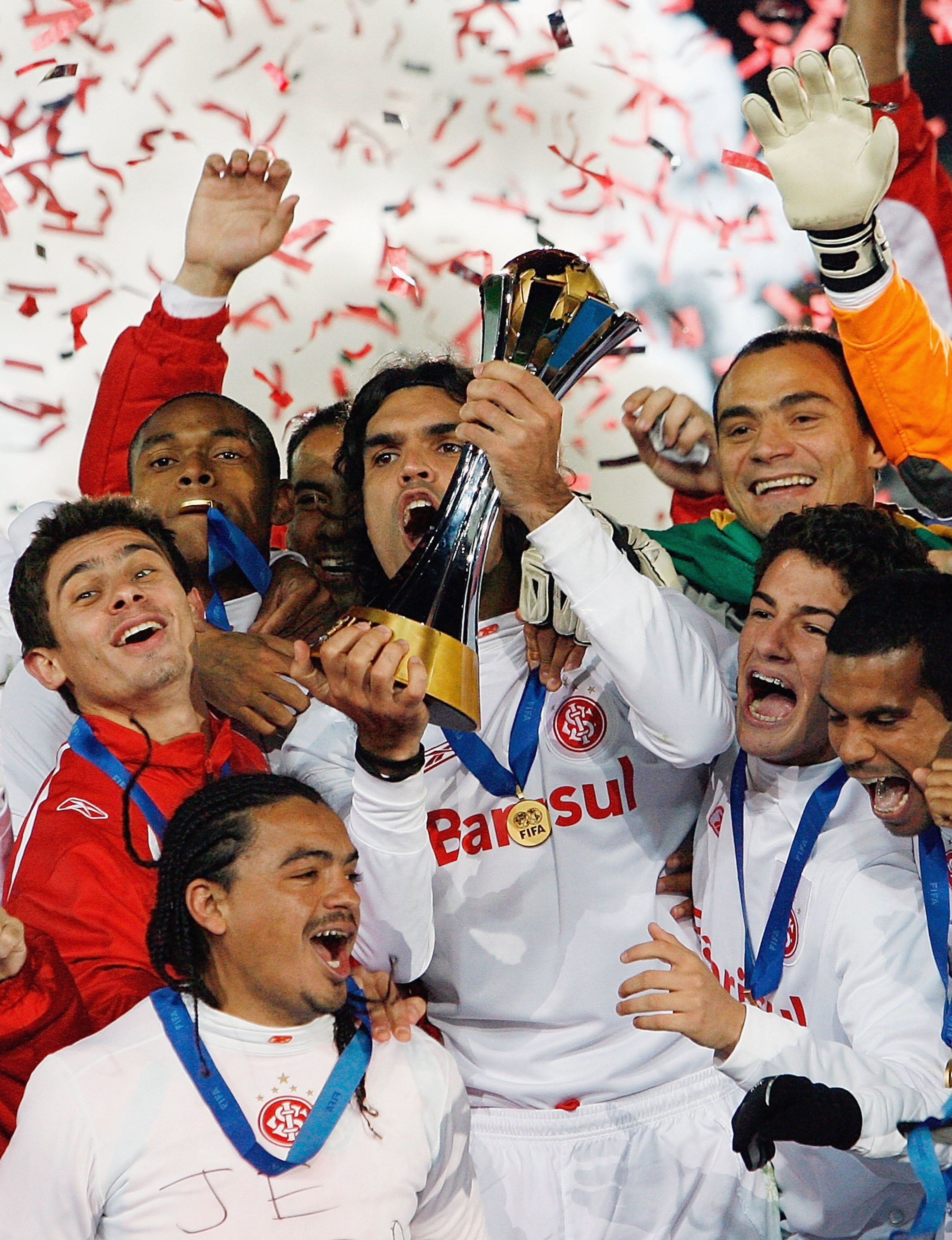 YOKOHAMA, JAPAN - DECEMBER 17:  Sport Club Internaciona players celebrate with the cup after winning the final of the FIFA Club World Cup Japan 2006 between Sport Club Internacional and FC Barcelona at the International Stadium Yokohama on December 17, 20