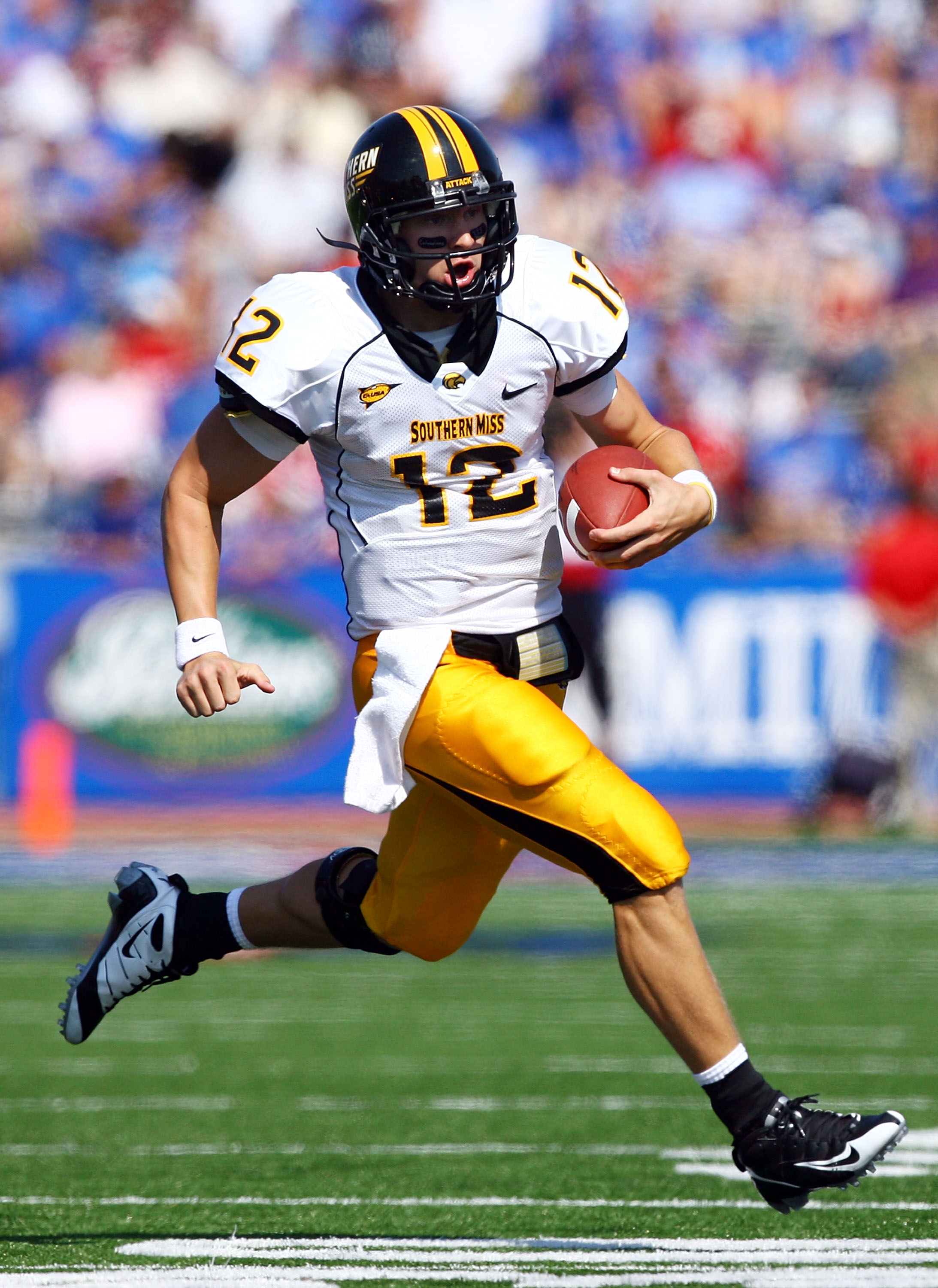 LAWRENCE, KS - SEPTEMBER 26:  Quarterback Austin Davis #12 of the Southern Mississippi Golden Eagles scrambles during the game against the Kansas Jayhawks on September 26, 2009 at Memorial Stadium in Lawrence, Kansas.  (Photo by Jamie Squire/Getty Images)