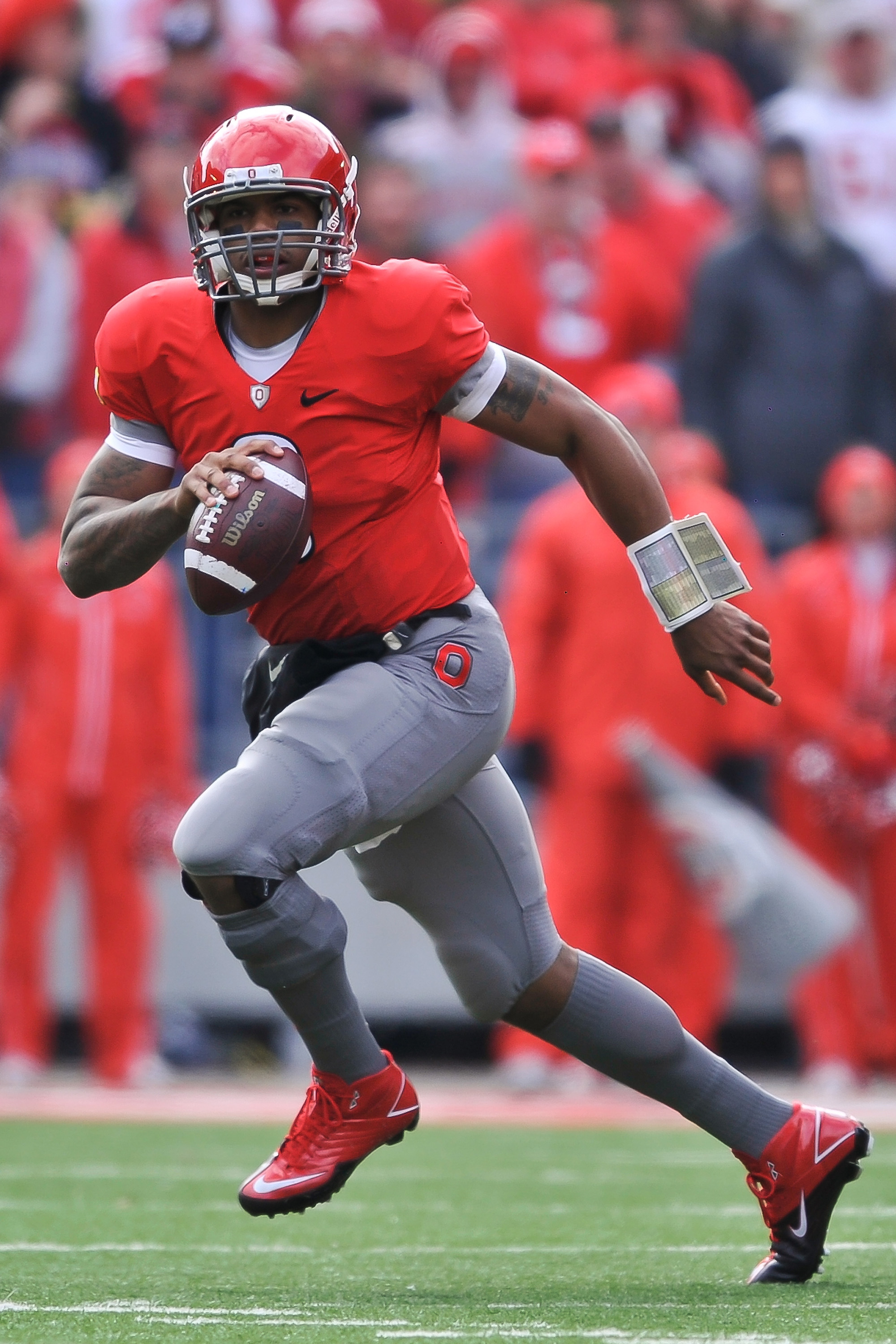 COLUMBUS, OH - NOVEMBER 27:  Quarterback Terrelle Pryor #2 of the Ohio State Buckeyes rolls out of the pocket against the Michigan Wolverines at Ohio Stadium on November 27, 2010 in Columbus, Ohio.  (Photo by Jamie Sabau/Getty Images)