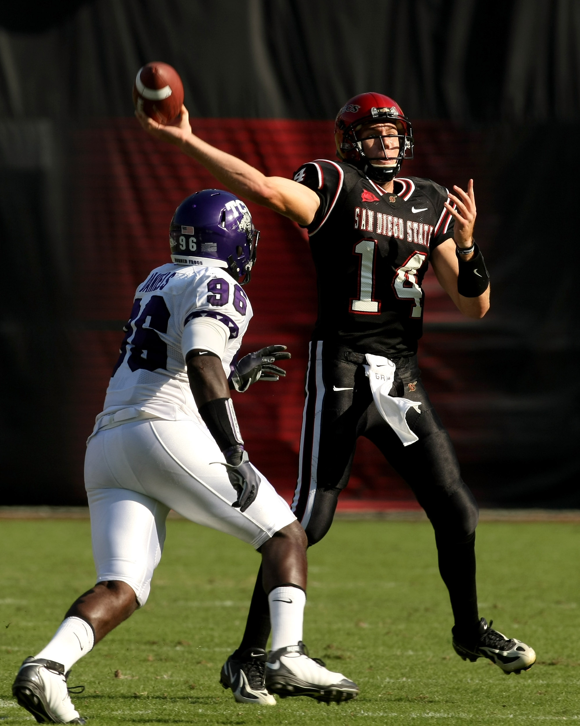 SAN DIEGO - NOVEMBER 7:  Quarterback Ryan Lindley #14 of the San Diego State Aztecs throws a pass over defensive end Wayne Daniels #96 of the Texas Christian University Horned Frogs on November 7, 2009 at Qualcomm Stadium in San Diego, California.    (Pho