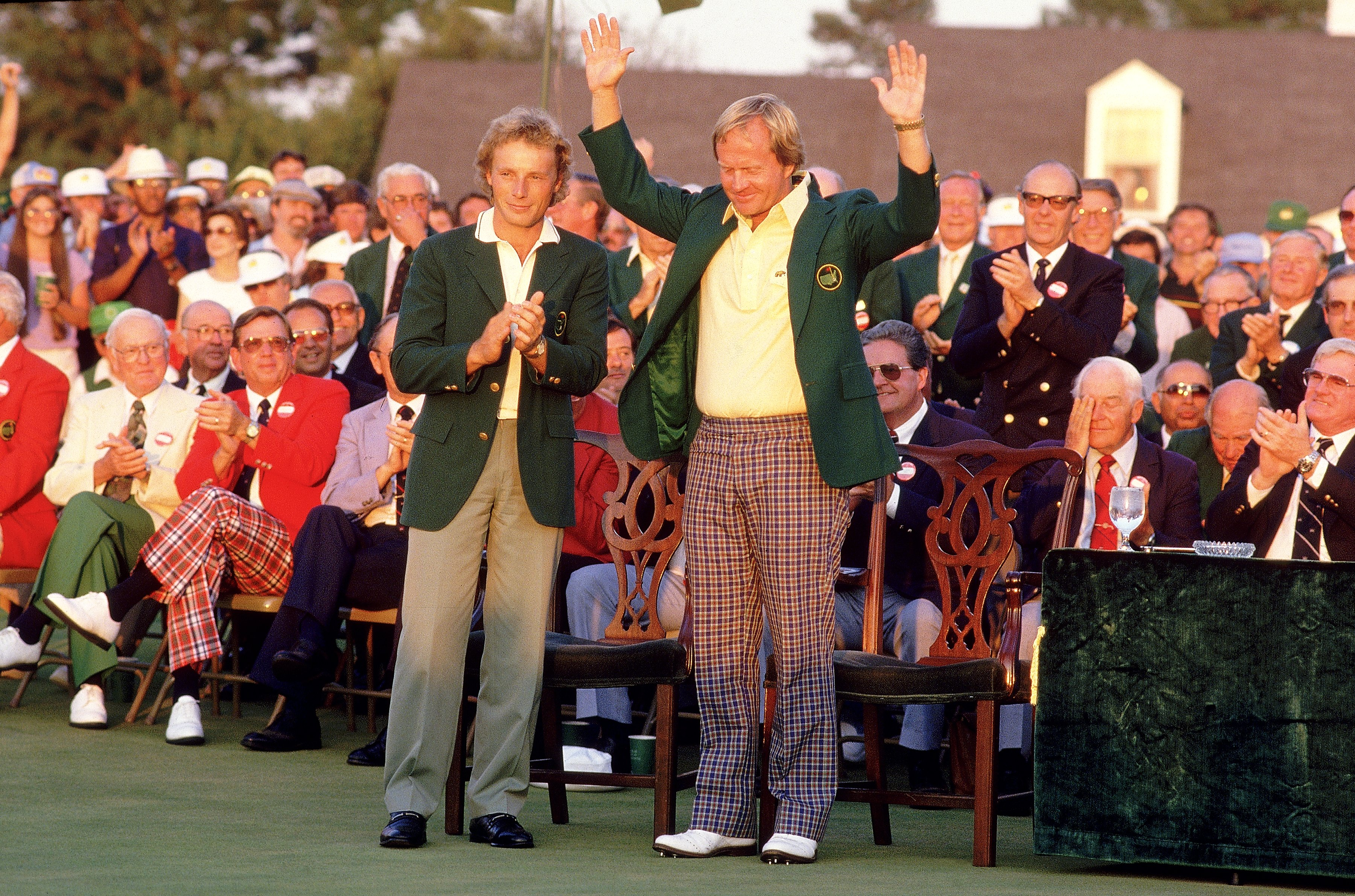 13 Apr 1986:  Jack Nicklaus of the USA receives the Green Jacket from previous winner Bernhard Langer of Germany after victory in the US Masters at Augusta National in Georgia, USA. Mandatory Credit: David Cannon /Allsport