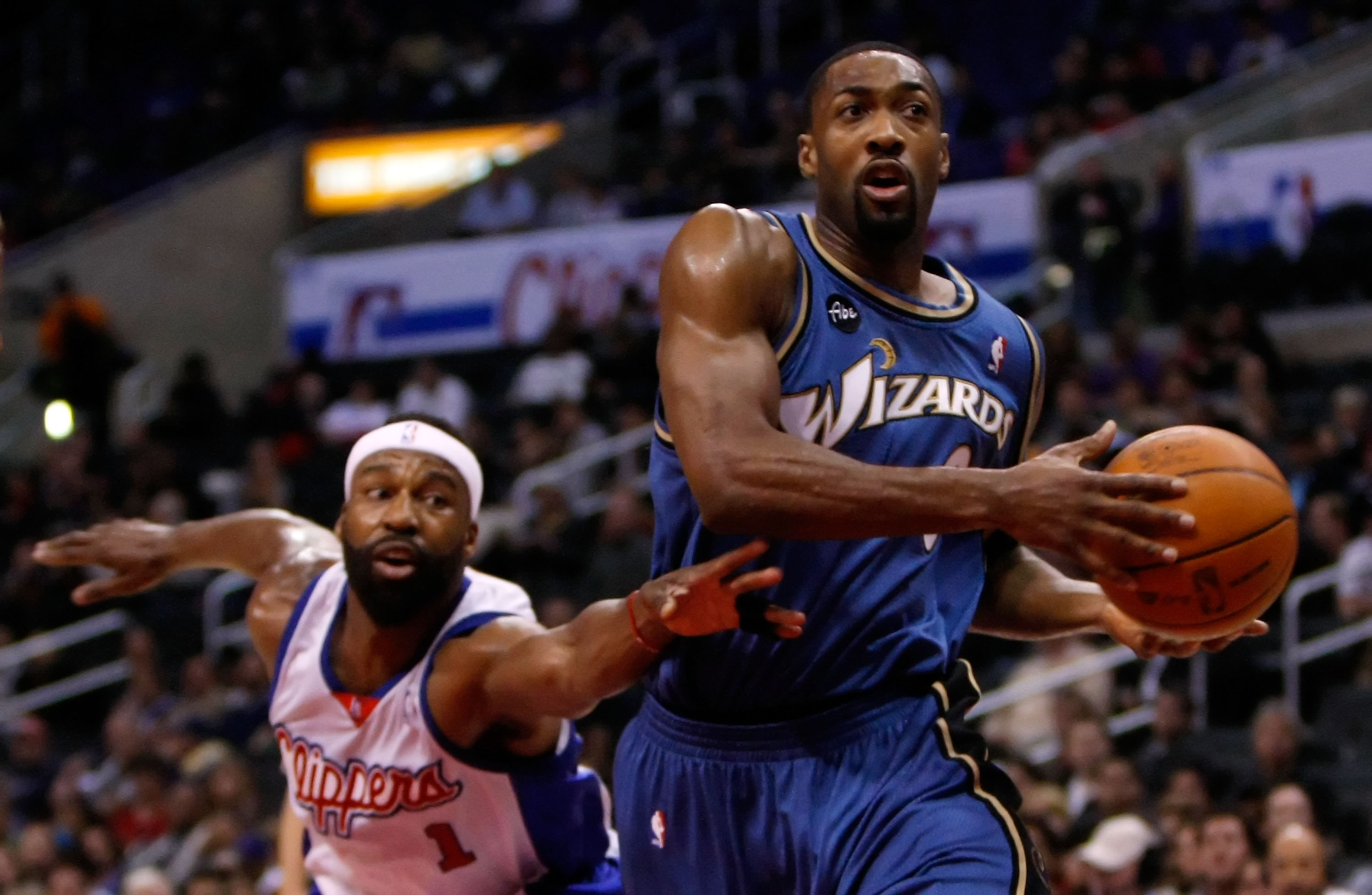 LOS ANGELES, CA - DECEMBER 14:  Gilbert Arenas #0 of the Washington Wizards drives to the basket as Baron Davis #1 of the Los Angeles Clippers lunges to steal the ball in the first half at Staples Center on December 14, 2009 in Los Angeles, California. NO