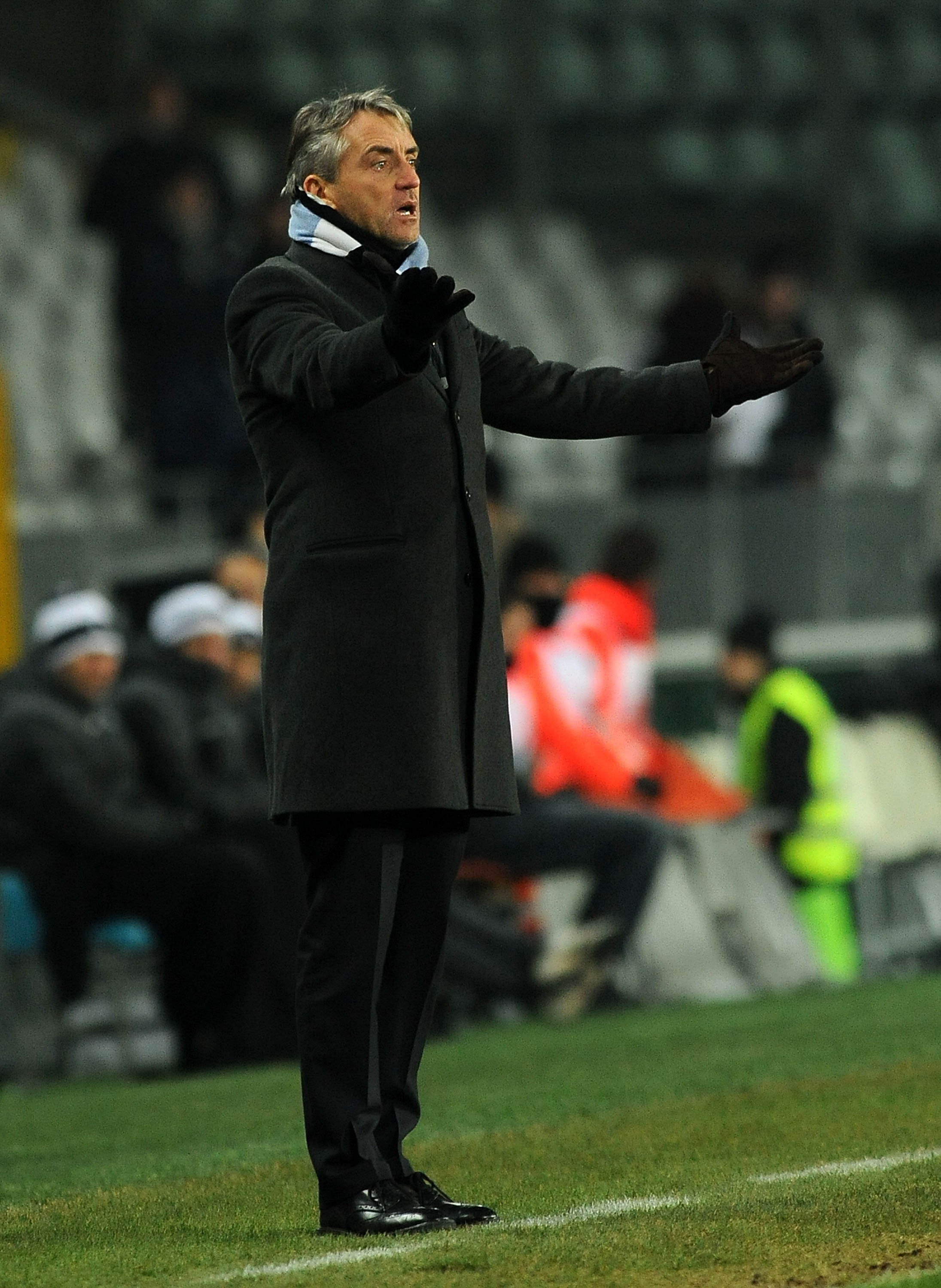 TURIN, ITALY - DECEMBER 16: Head coach Roberto Mancini of Manchester City reacts during the UEFA Europa League group A match between Juventus FC and Manchester City at Stadio Olimpico di Torino on December 16, 2010 in Turin, Italy. (Photo by Massimo Cebre