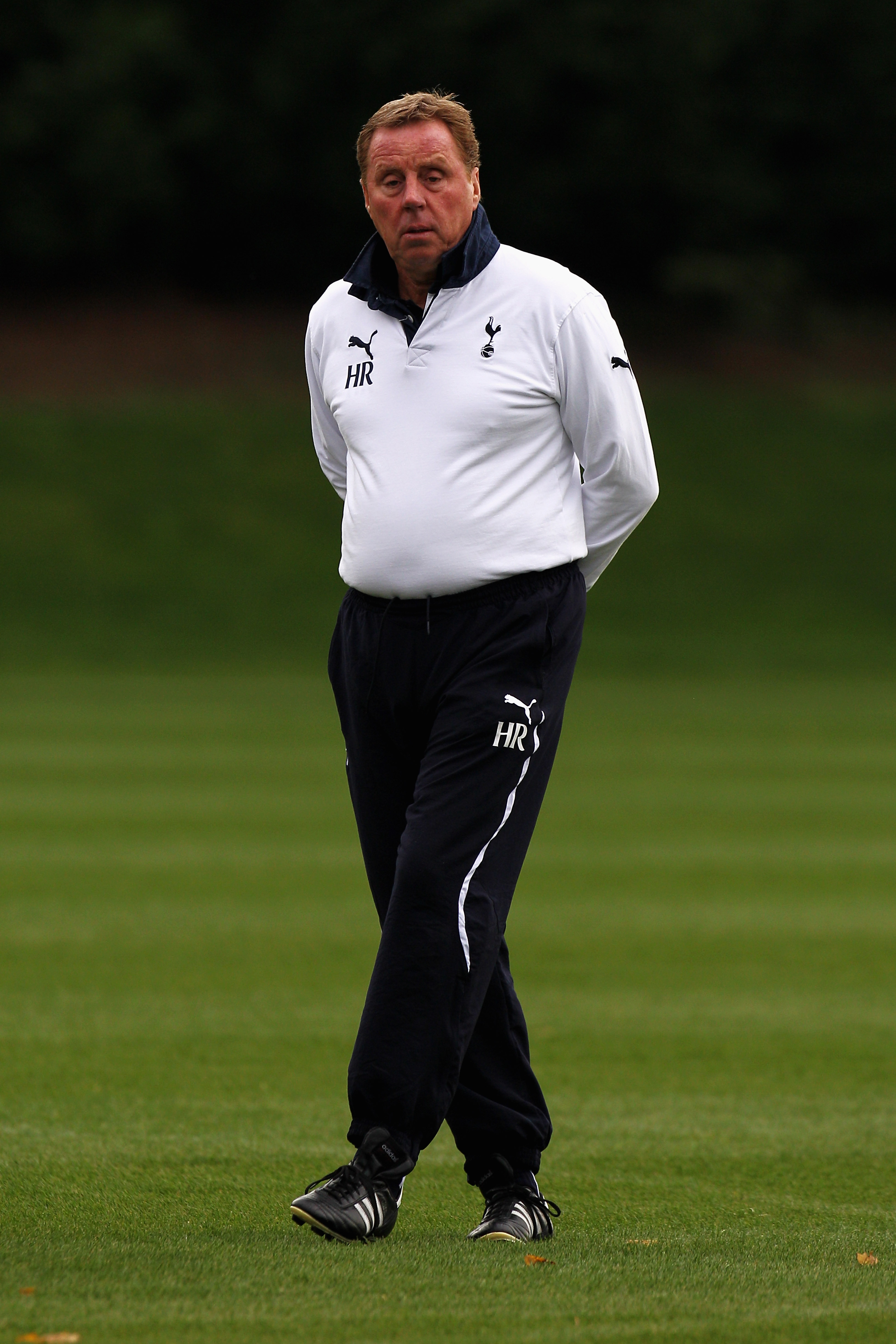 LONDON, ENGLAND - NOVEMBER 01:  Tottenham Manager,  Harry Redknapp looks on during the Tottenham Hotspur training session ahead of their UEFA Champions League group stage match against Inter Milan at Tottenham Hotspur Training Ground on November 1, 2010 i