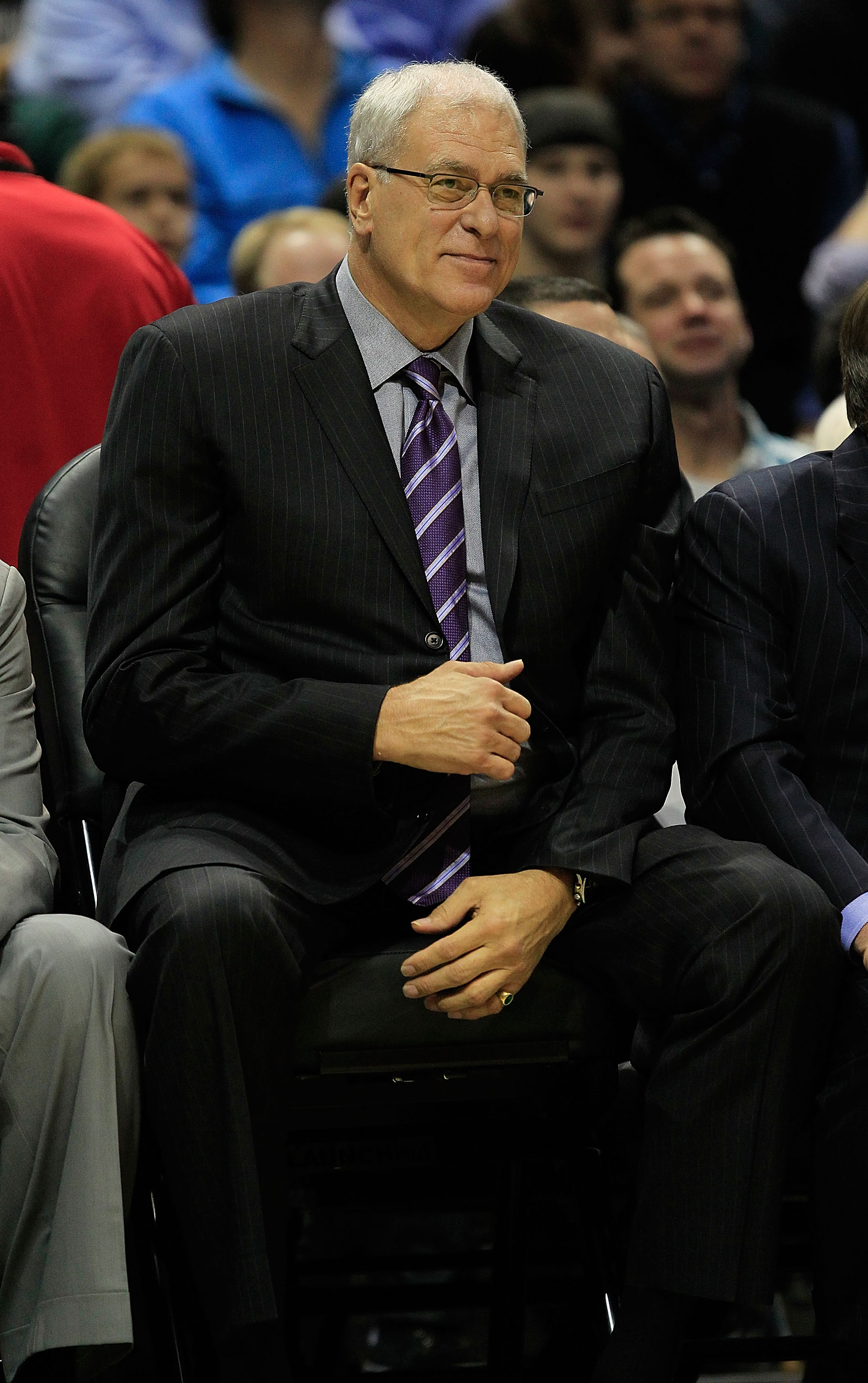 MILWAUKEE - NOVEMBER 16: Head coach Phil Jackson of the Los Angeles Lakers smiles as he watches his team take on the Milwaukee Bucks at the Bradley Center on November 16, 2010 in Milwaukee, Wisconsin. The Lakers defeated the Bucks 118-107. NOTE TO USER: U