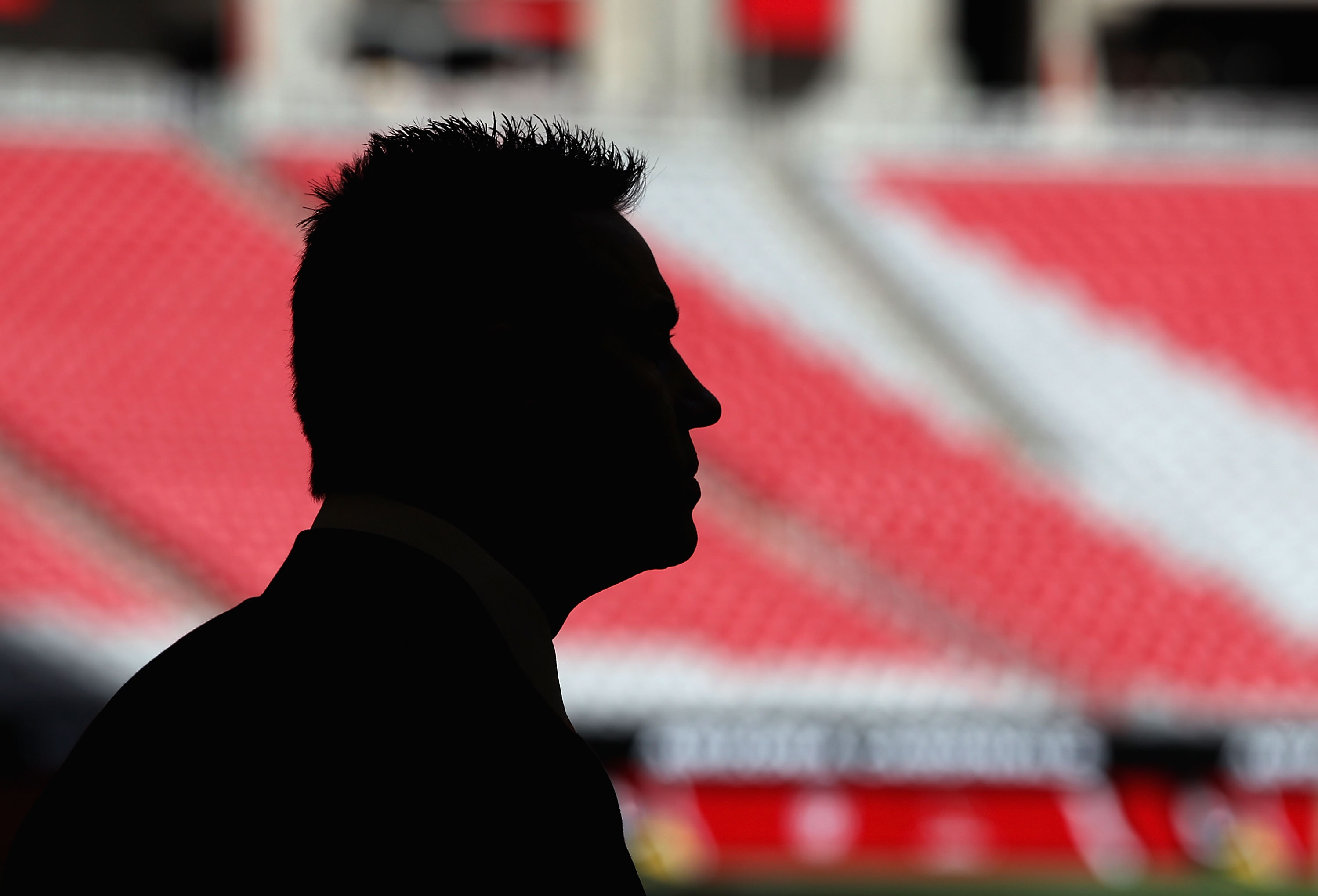 GLENDALE, AZ - DECEMBER 05:  Former NFL quarterback Kurt Warner stands on the field before the NFL game between the St. Louis Rams and the Arizona Cardinals at the University of Phoenix Stadium on December 5, 2010 in Glendale, Arizona.  (Photo by Christia