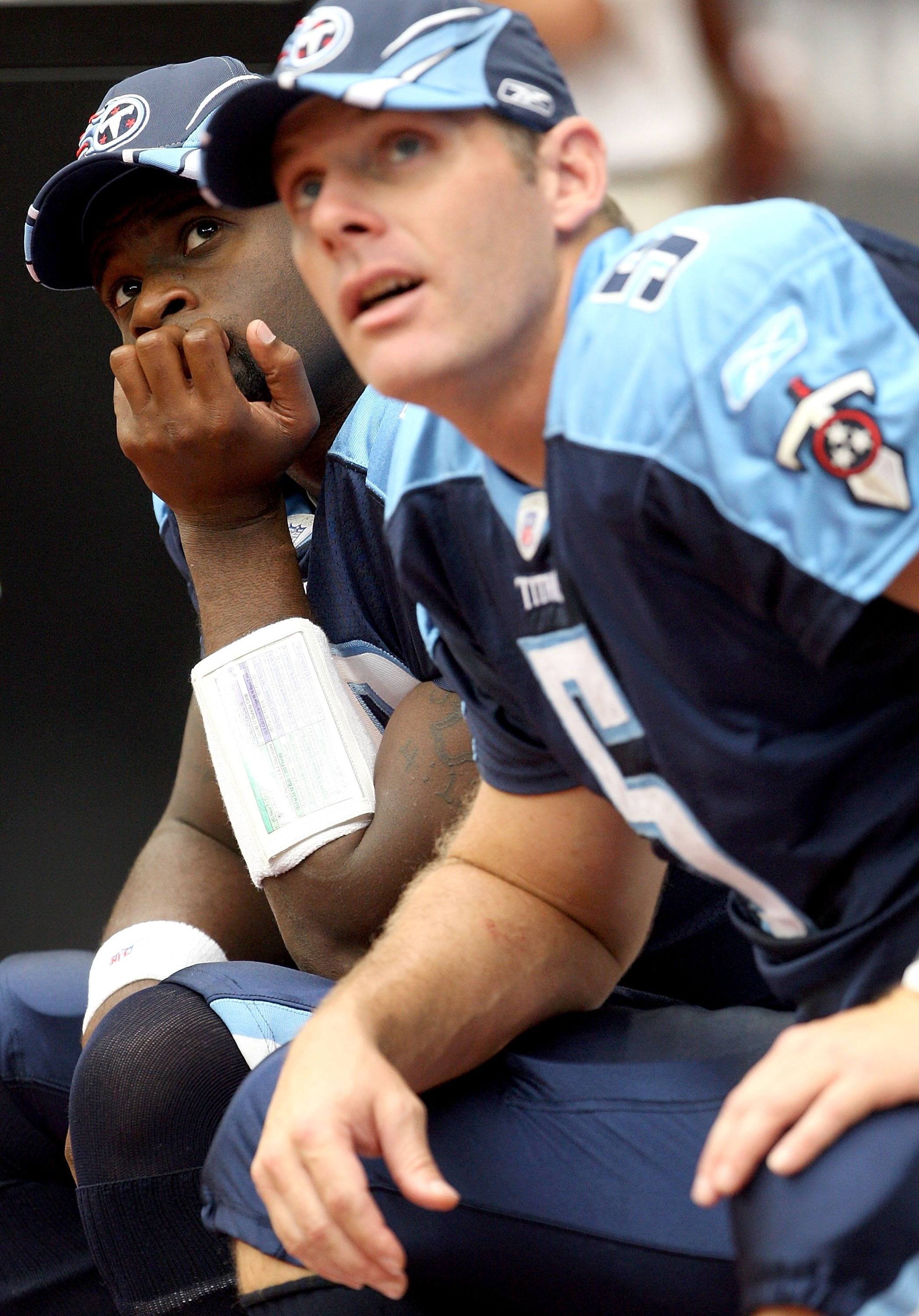 HOUSTON - OCTOBER 21:  Quarterback Vince Young #10 of the Tennessee Titans sits on the bench next to Kerry Collins #5 as they both watch action on the jumbotron during the 1st half of the game against the Houston Texans on October 21, 2007 at Reliant Stad