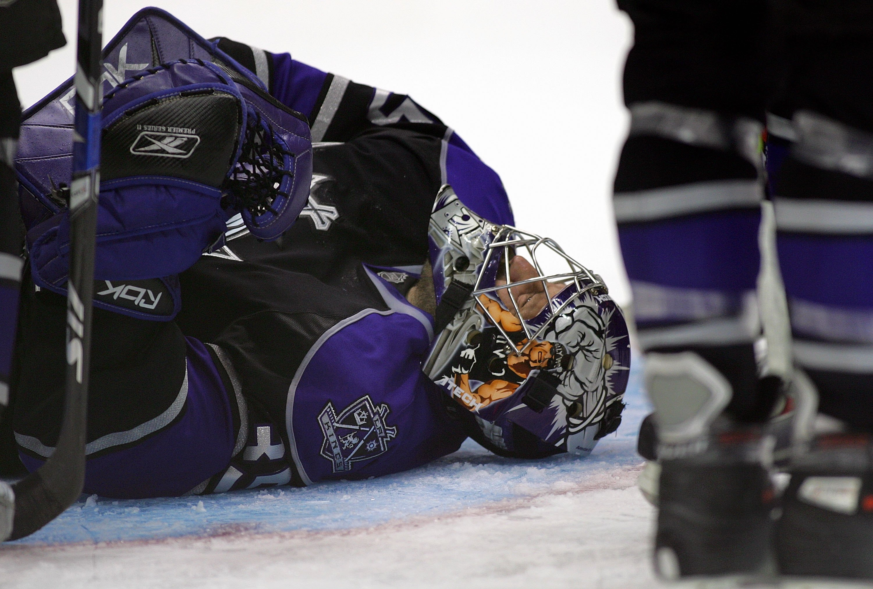 LOS ANGELES, CA - DECEMBER 01:  Goaltender Jason LaBarbera #35 of the Los Angeles Kings lays on the ice after being injured on a play in the crease late in third period during their NHL game against the Colorado Avalanche on December 1, 2007 at the Staple