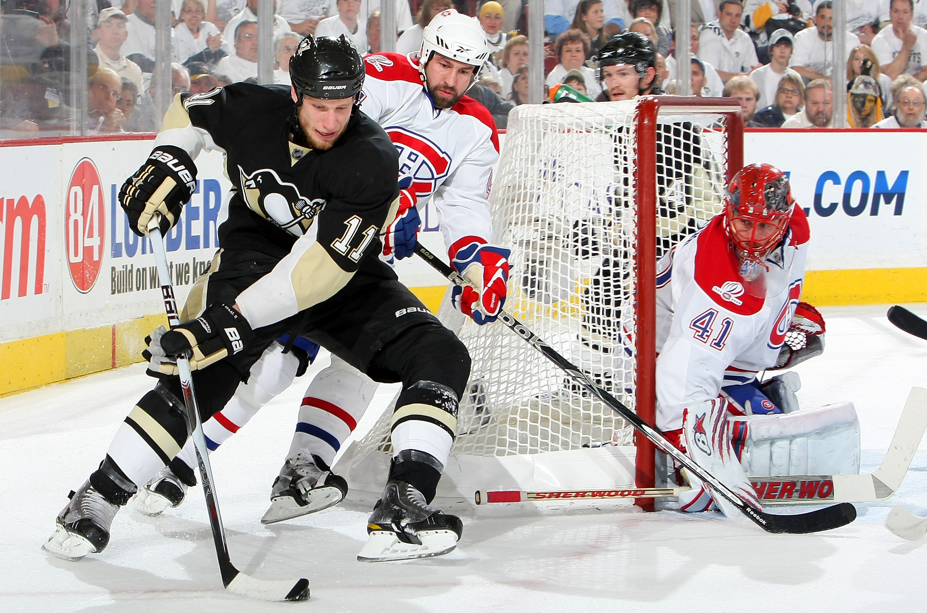 PITTSBURGH - MAY 12:  Jordan Staal #11 of the Pittsburgh Penguins attempts a wrap around on Jaroslav Halak #41 of the Montreal Canadiens as Roman Hamrlik #44 of the Canadiens defends in Game Seven of the Eastern Conference Semifinals during the 2010 Stanl